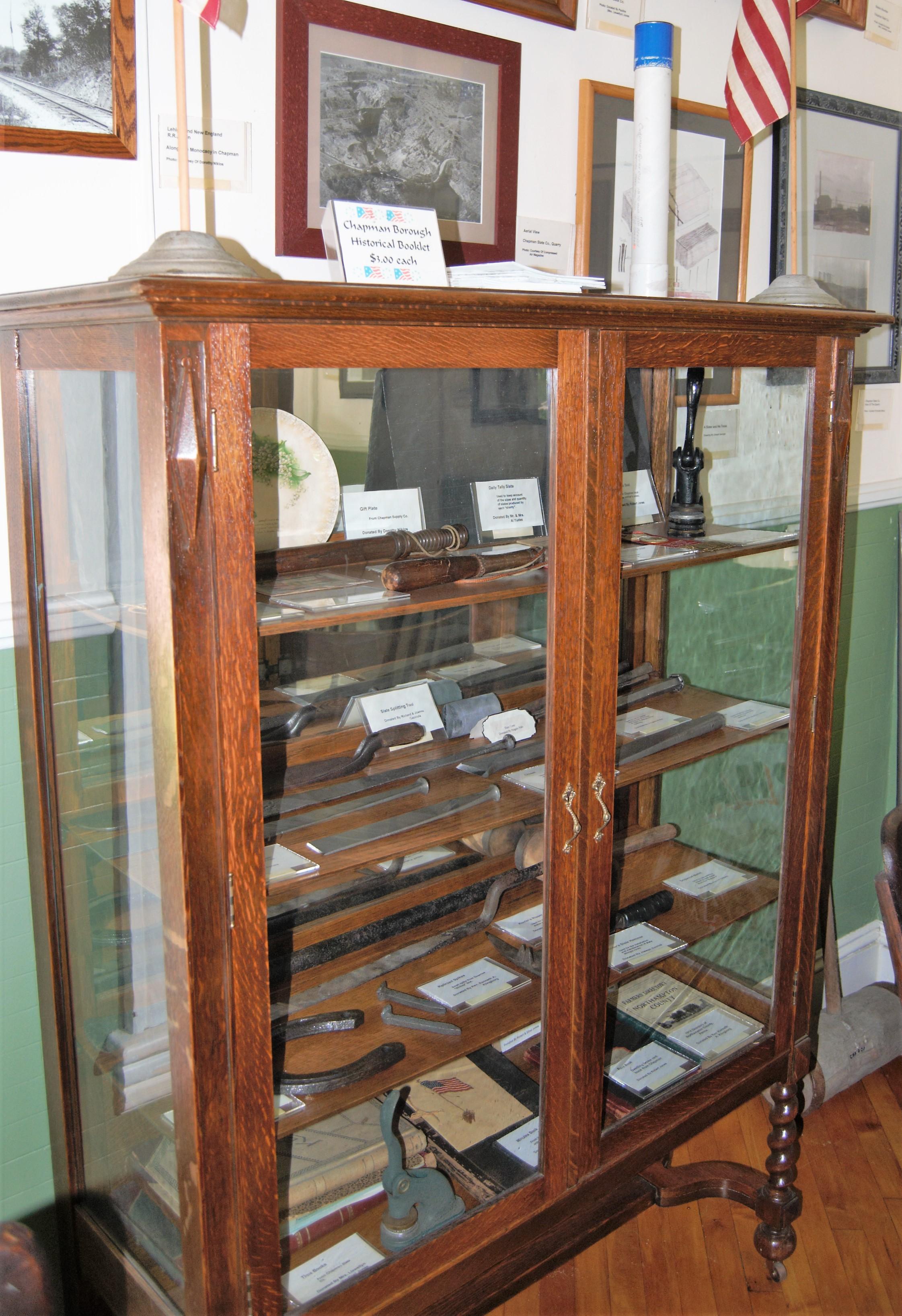 - Case displaying slate working tools