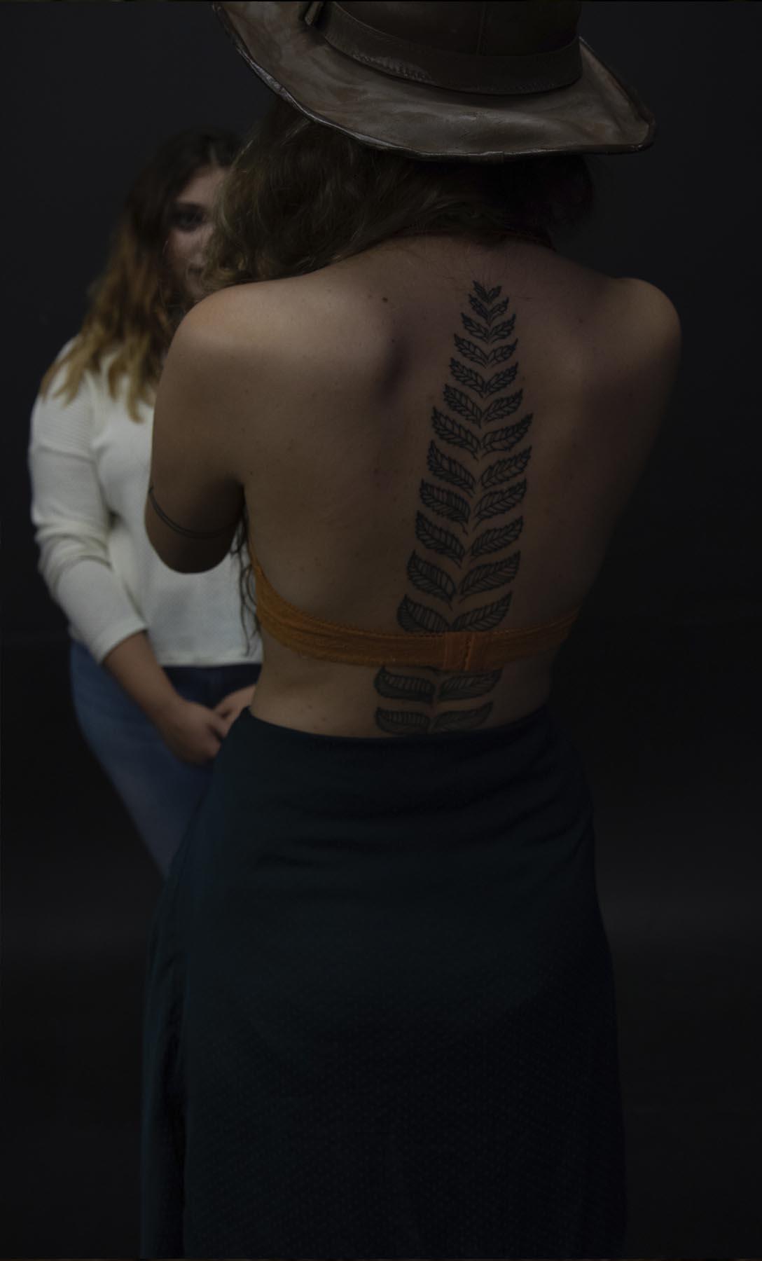 large back tattoo woman.jpg