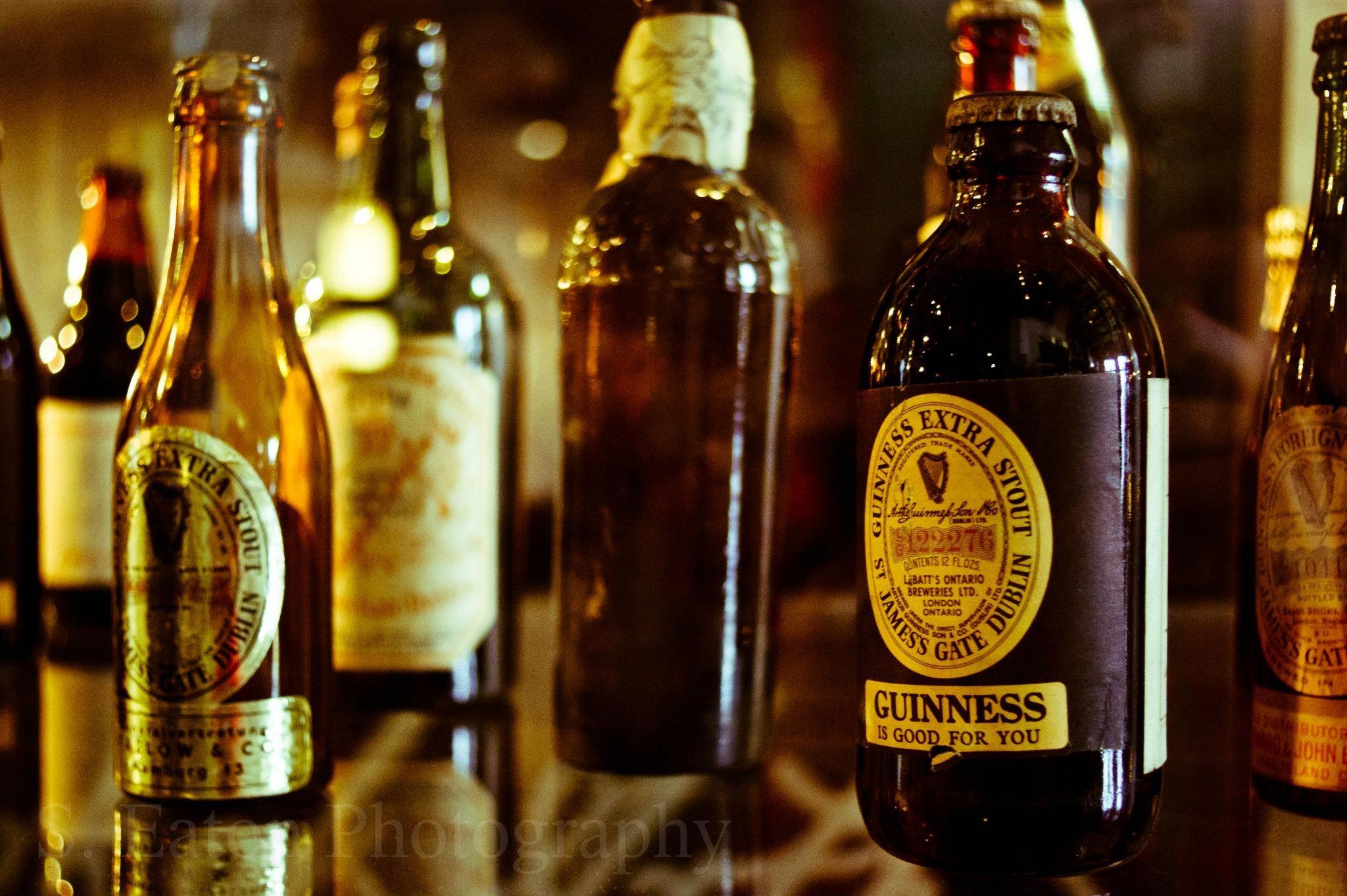 Guinness bottles over the years - Guinness Museum, St. James Gate, Dublin, Ireland