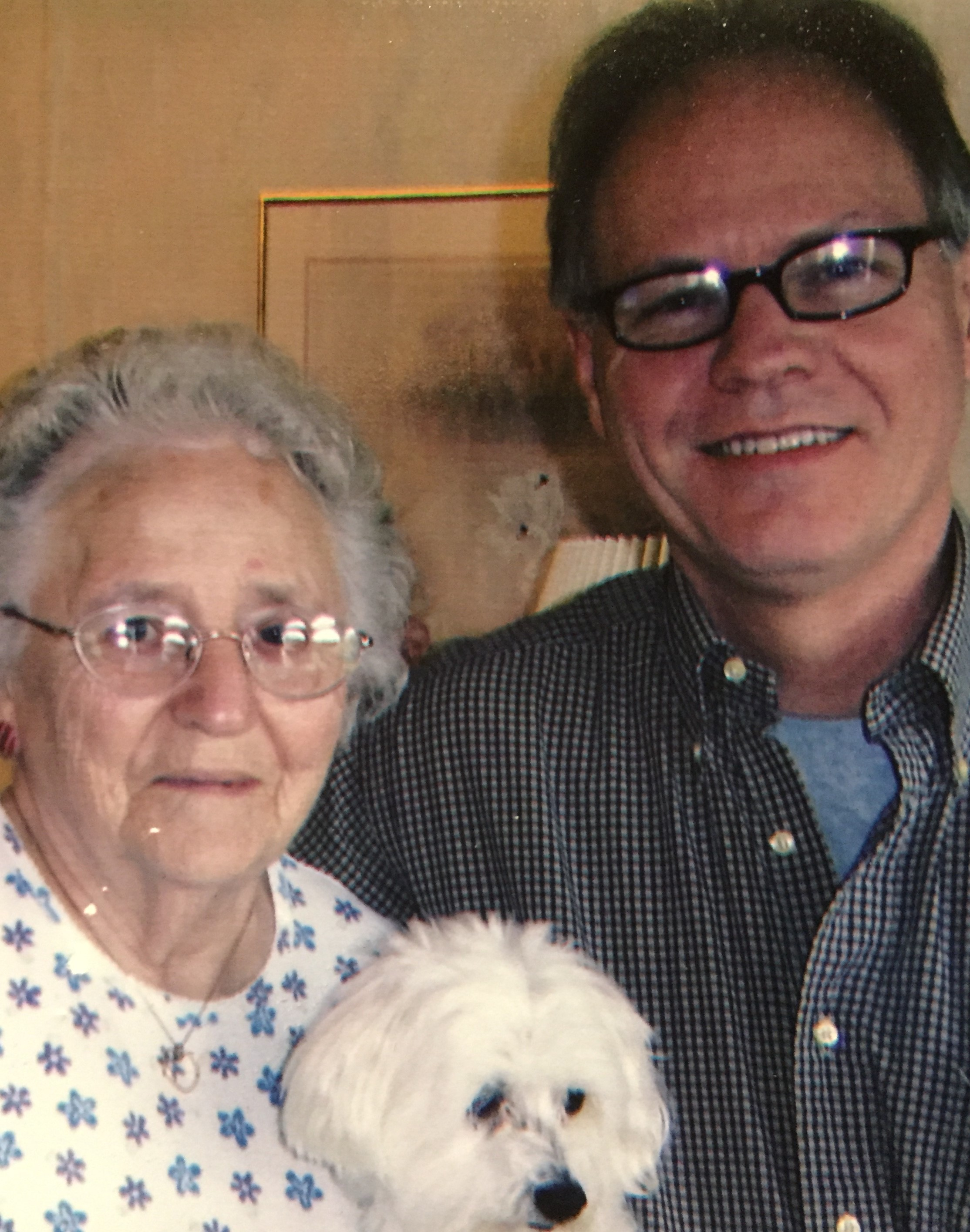 "John and his ""Mom"" Helen with her dog King.  We lost Helen in 2010 and King followed soon after.  John is a flight attendant for Delta Airlines and had been with Delta for 41 years. -"