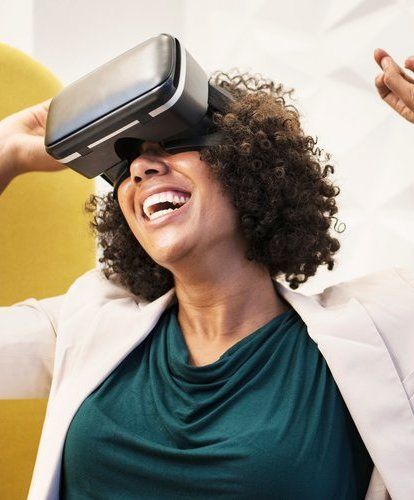 Young black woman wearing an AR VR device.jpeg