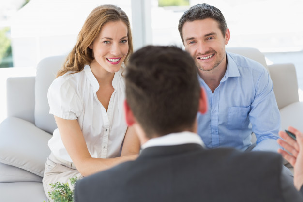 smiling-couple-in-meeting-with-a-financial-adviser_13339-108728.jpg