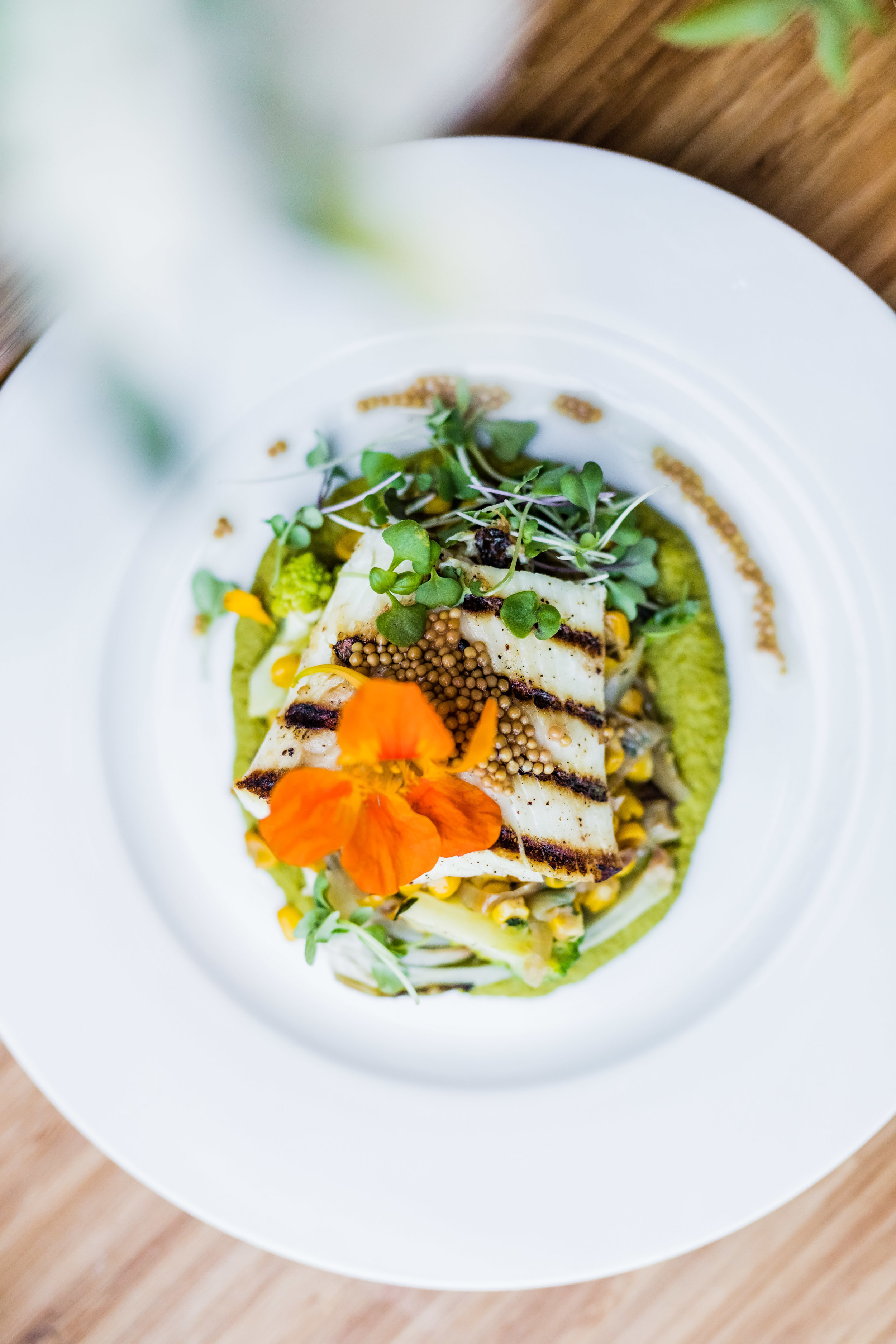 Halibut with pickled mustard seeds and edible flowers
