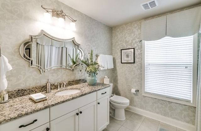 This bright bathroom is adorable!! We love how the mirror adds a unique look that makes it a special addition. The bright colors show off the little details, obessed! Check out our website! https://buff.ly/2SwlXL3⠀ .⠀ .⠀ .⠀ .⠀ .⠀ #lovethislook #popsofcolor #inlove  #tatesdesign #greenvillesc #lovegreenville #lovesouthcarolina #vintage #color #interiordesign #dreamhouse #yeahthatsgreenville #comfy #colorcoordinated #windows #bathroom #naturalcolor #unique #newlooks #interiorhome #interior4inspo #interiordesigninspiration #dreamhomeinspo #accessories #traditionalinterior  #interiordecor #decor #greenvilleinteriordesign #greenville360 #designhome
