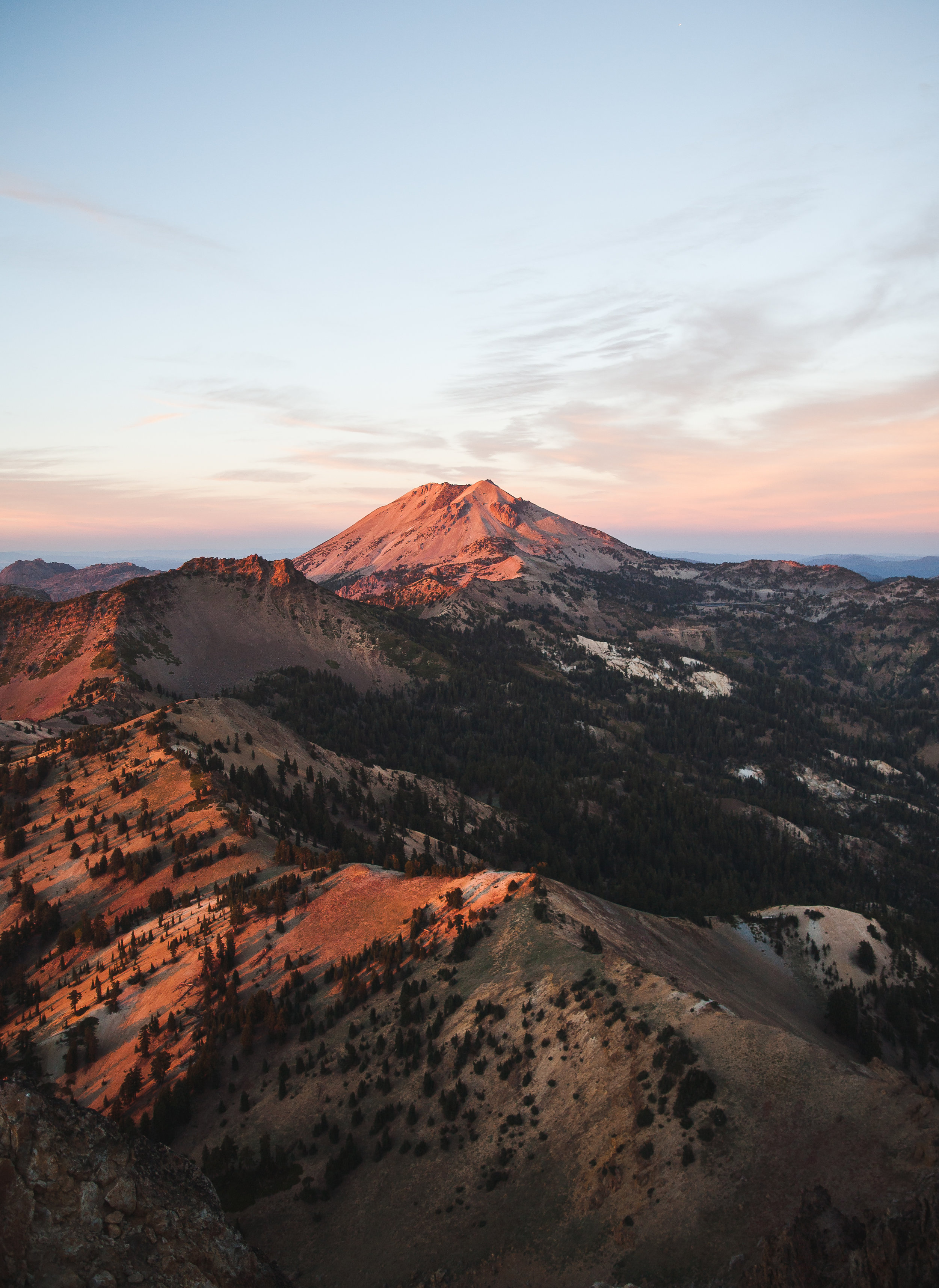 A view of everything. mount Diller and Eagle peak in line in the foreground, Lassen peak in the center, Lake Helen to the right of the peak, and Chaos Crags to the left of the peak.