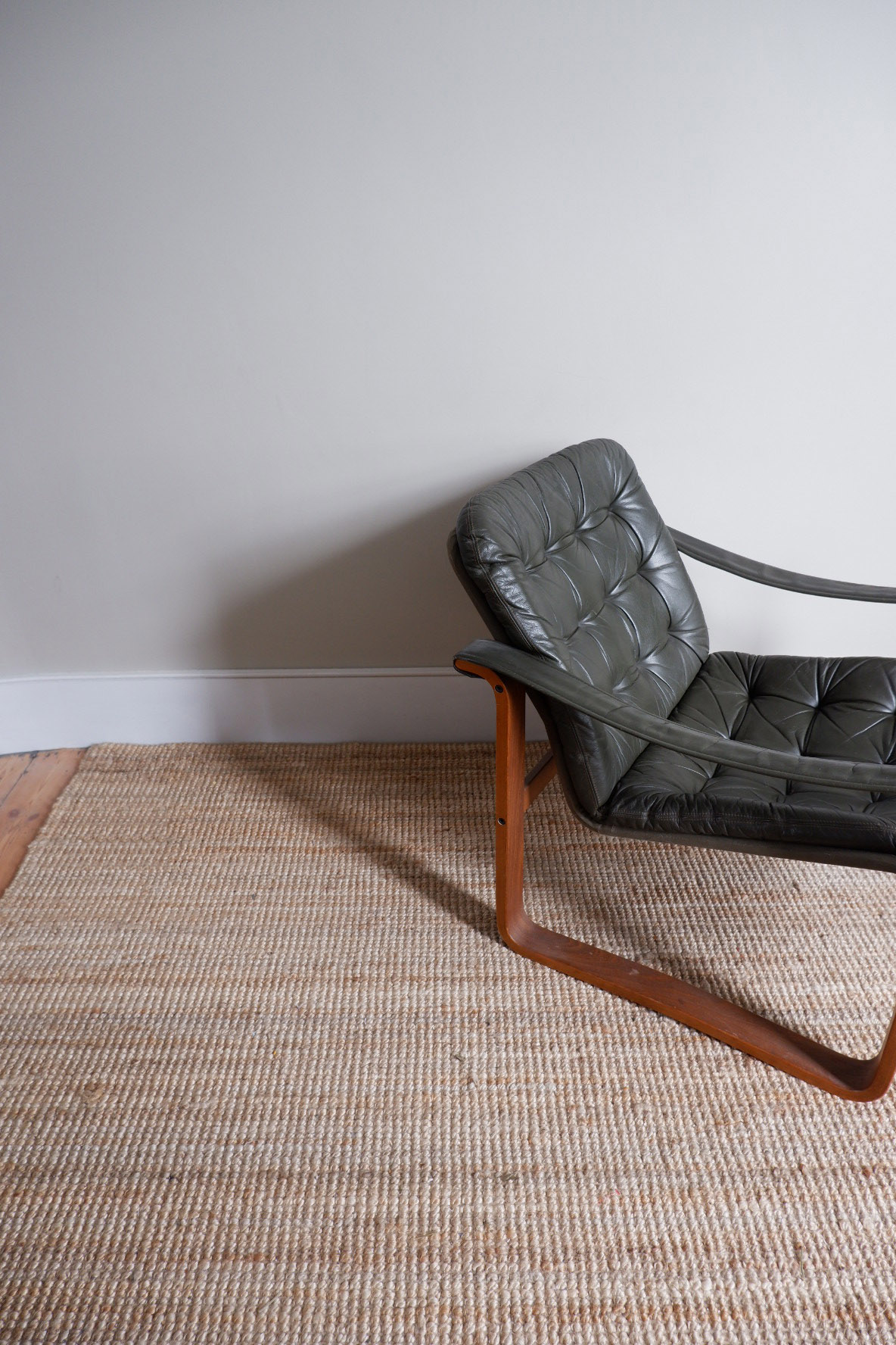 leather chair on mat.JPG