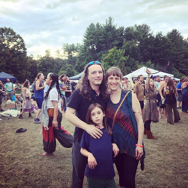 Finally got brave enough to take Milo to his first hippy fest.  His anguished expression looks like a silent cry for help, but he got into it eventually.