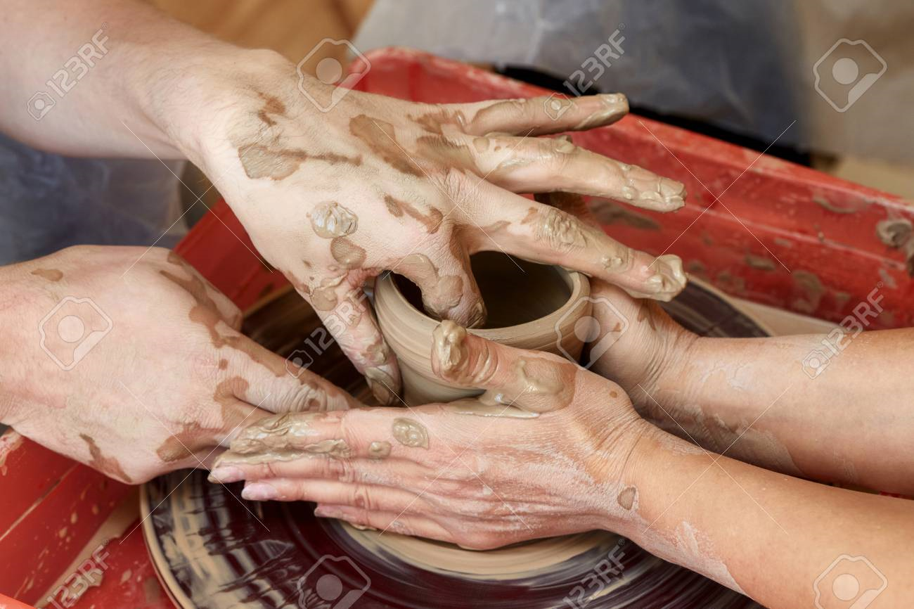 88121088-hands-of-two-people-create-pot-on-potter-s-wheel-teaching-pottery-carftman-s-hands-guiding_123rf.png