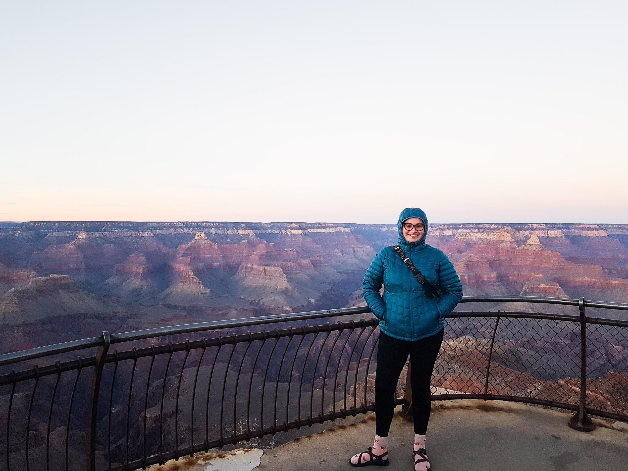 christina gray grayt at the grand canyon smiling woman dusk kavu bag marmot jacket
