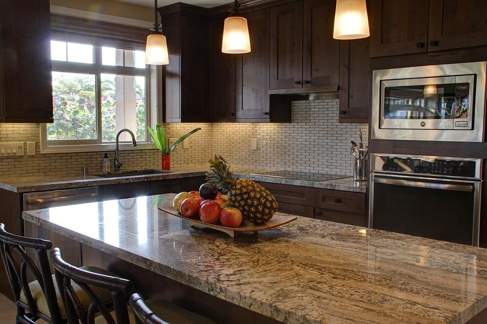 Photo: Dark wood cabinetry. https://pixabay.com/photos/home-kitchen-modern-luxury-kitchen-1416381/