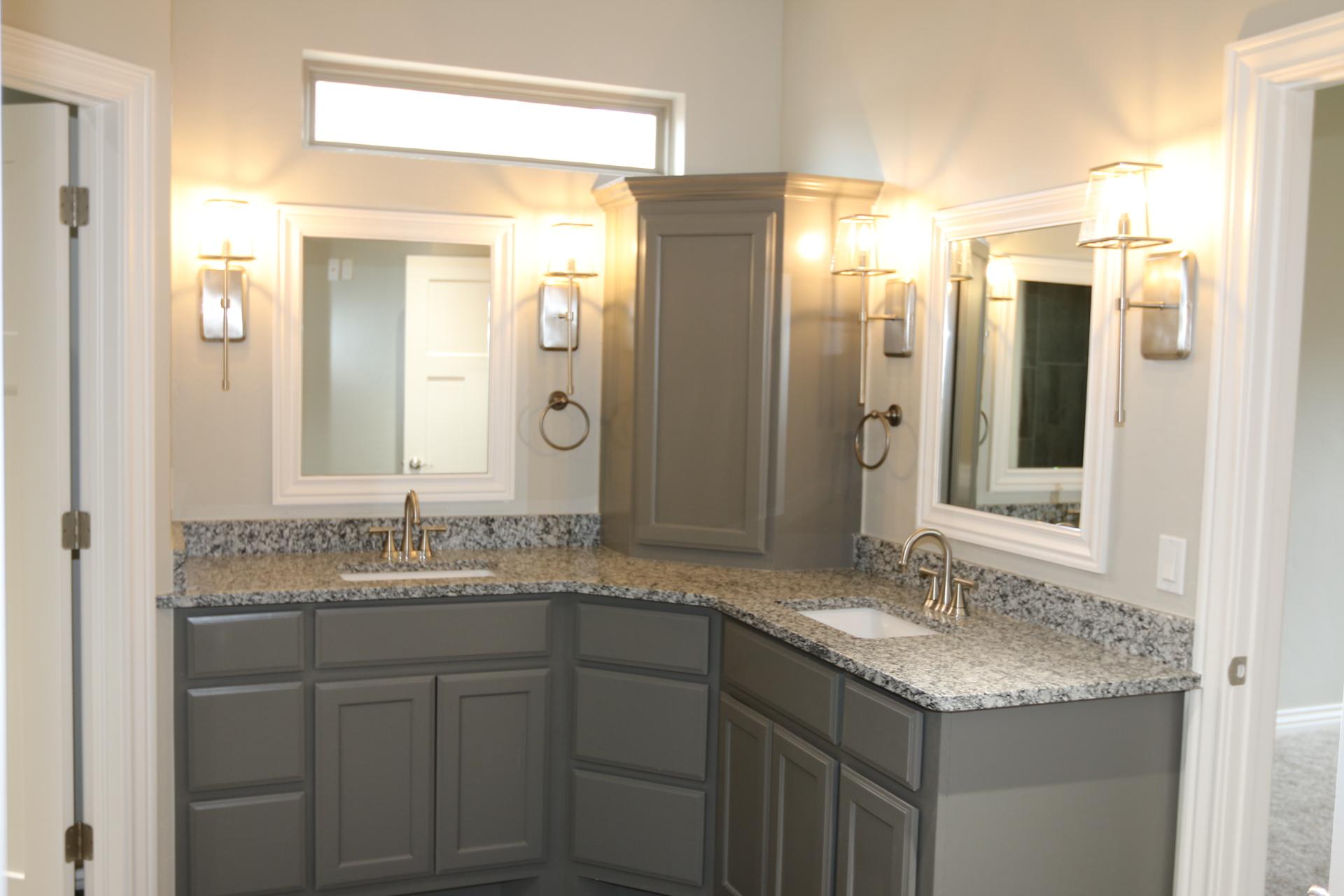 dual vanity bathroom dark grey cabinets.jpeg