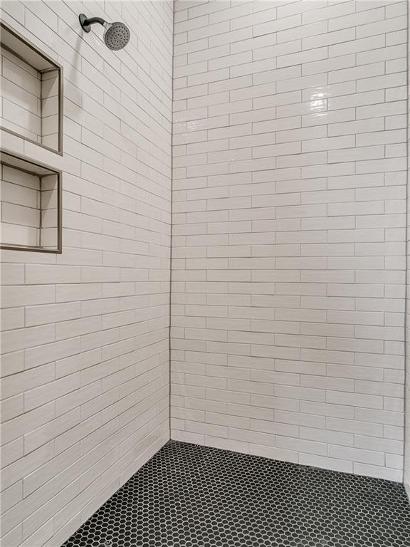 white subway tile shower.jpg