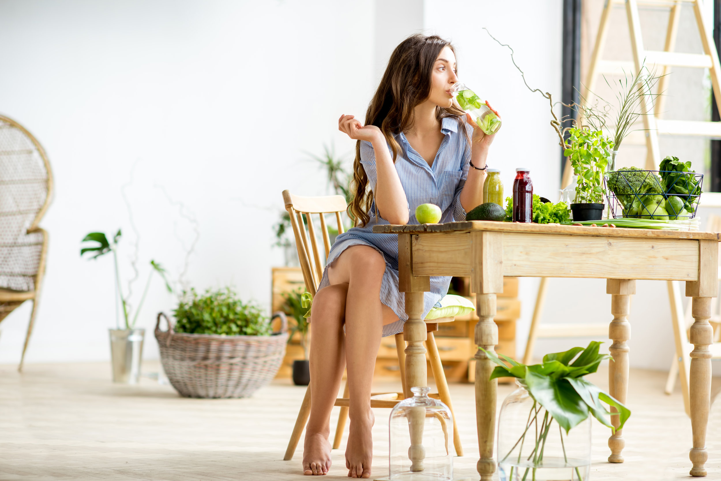 woman sitting at table with greens.jpeg