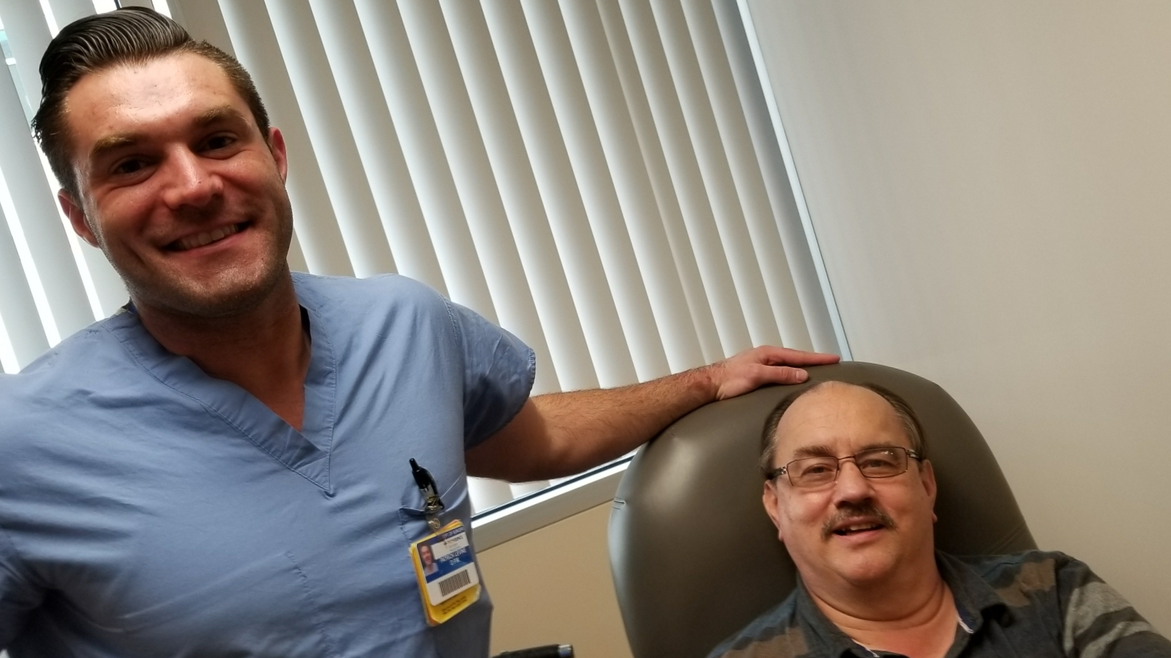 Dr. Levine with a long-time patient in the office