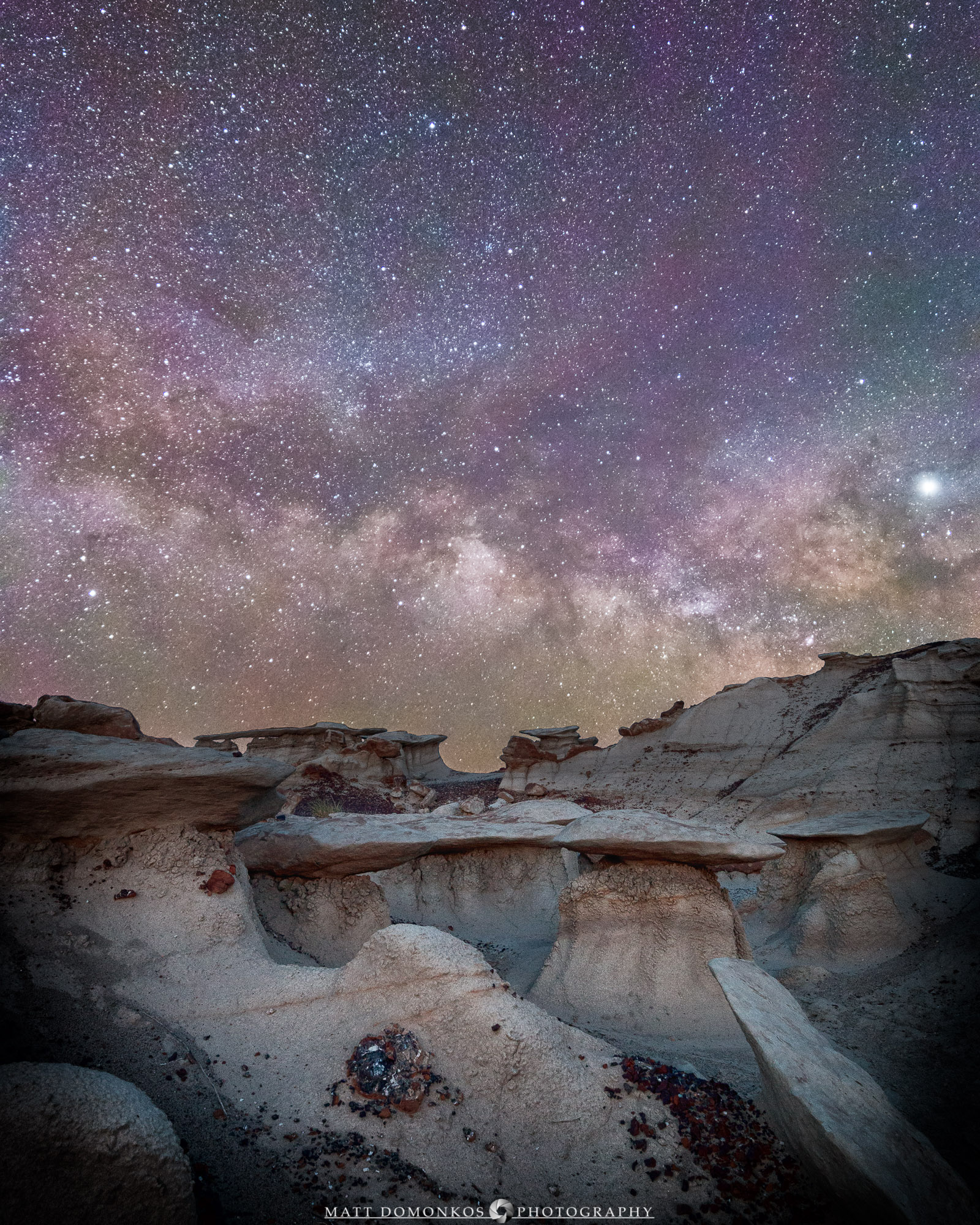 Prominent Jupiter overlooks the scene at the Bisti Badlands.   At the tail end of three nights of shooting, I had little energy to hike further into the formation than this location! Fortunately, Bisti is rich with its characteristic hoodoos and unusual formations. One of two scenes composed using blue hour imagery of the landscape this night.   In this case, I used my kit--a Canon 70D and a 14mm f2.8 Rokinon lens. I shoot a 10 s exposures generally with this set up, a little less than half what the 500 rule recommends. At ISO 6400 or even 3200, the images still accumulate enough light to differentiate colors with limited noise.   Probably the best investment in improving the signal to noise in my images has been the Starry Landscape Stacker software. Made from 10 light frames by Starry Landscape Stacker 1.8.0. Algorithm: Mean Min Hor Noise.   Cheers!