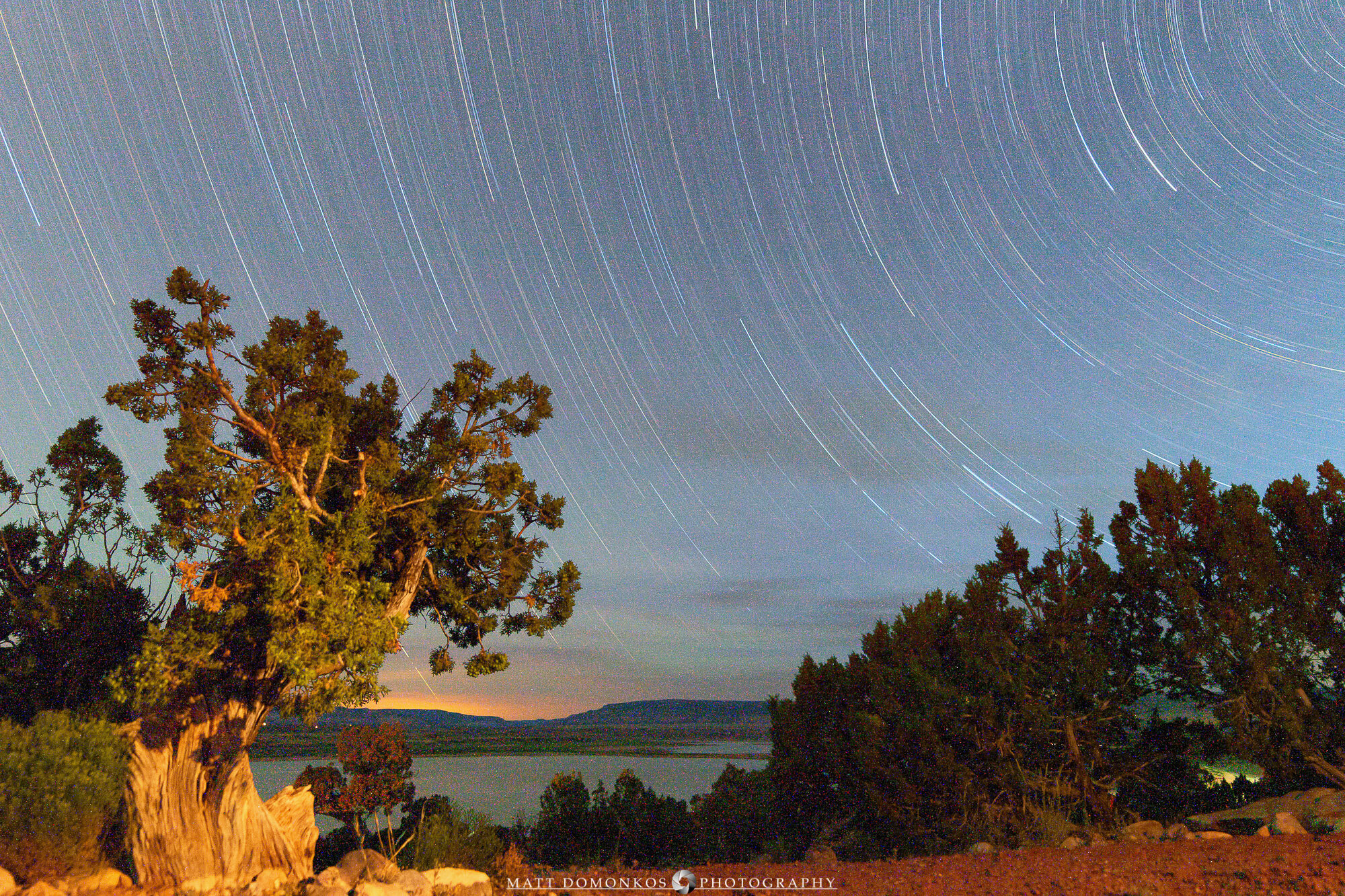 Star trails from my campground looking over Abiquiu Lake toward the horizon. I'm not exactly sure when I realized the shutter timer had failed, but the last image collected light for nearly an hour. That produced a number of hot pixels in the image, which make this a poor candidate for enlargement. Still, the features make an interesting composite.   Cheers!