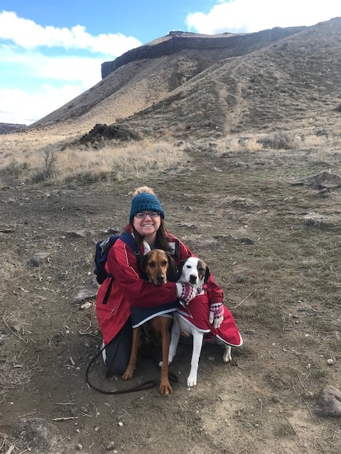 picture of woman and two hound dogs on a hike in Celebration Park
