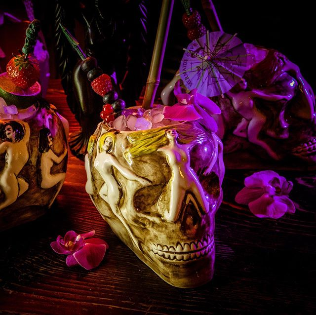 "Yeah we are still there! Starting with the Hurricane Skull Mug in three variations. Preorders start in June 2019. They will be available at www.cryptotikimugs.net 📷 by @pixeleye  Menu description: It's not exactly clear what drink was served in this mug. There are a few that are good guesses based on the name alone: the Merciless Virgin, Tropical Lei, and Passion Cocktail are all candidates. Since the Merciless Virgin is served in a pineapple, my vote is for the Passion Cocktail with the menu description; ""You be the Judge."" Notes: I lost my s#!t when I first saw this mug. It has sex, death, and booze all wrapped up in one hand-held treasure. It's been documented in an old newspaper photo taken at The Hurricane, and also in recent photos of two original mugs by one of the owner's descendants on Tiki Central. Sure, another original might show up some day, but as mentioned earlier, we're incredibly impatient so we're recreating this gem. Comes in three hair colors named for classic cuties: Bunny Blonde, Bettie Black, and Tempest Ginger! #cryptotikimugs #tikimugs #hurricaneskullmug #tikimug #tiki #polynesianpop #pixeleye #dirkbehlau #photography #photographer #fogmachine #skull #drinks #cocktails #tikiculture #tikicocktails #tikidrinks"