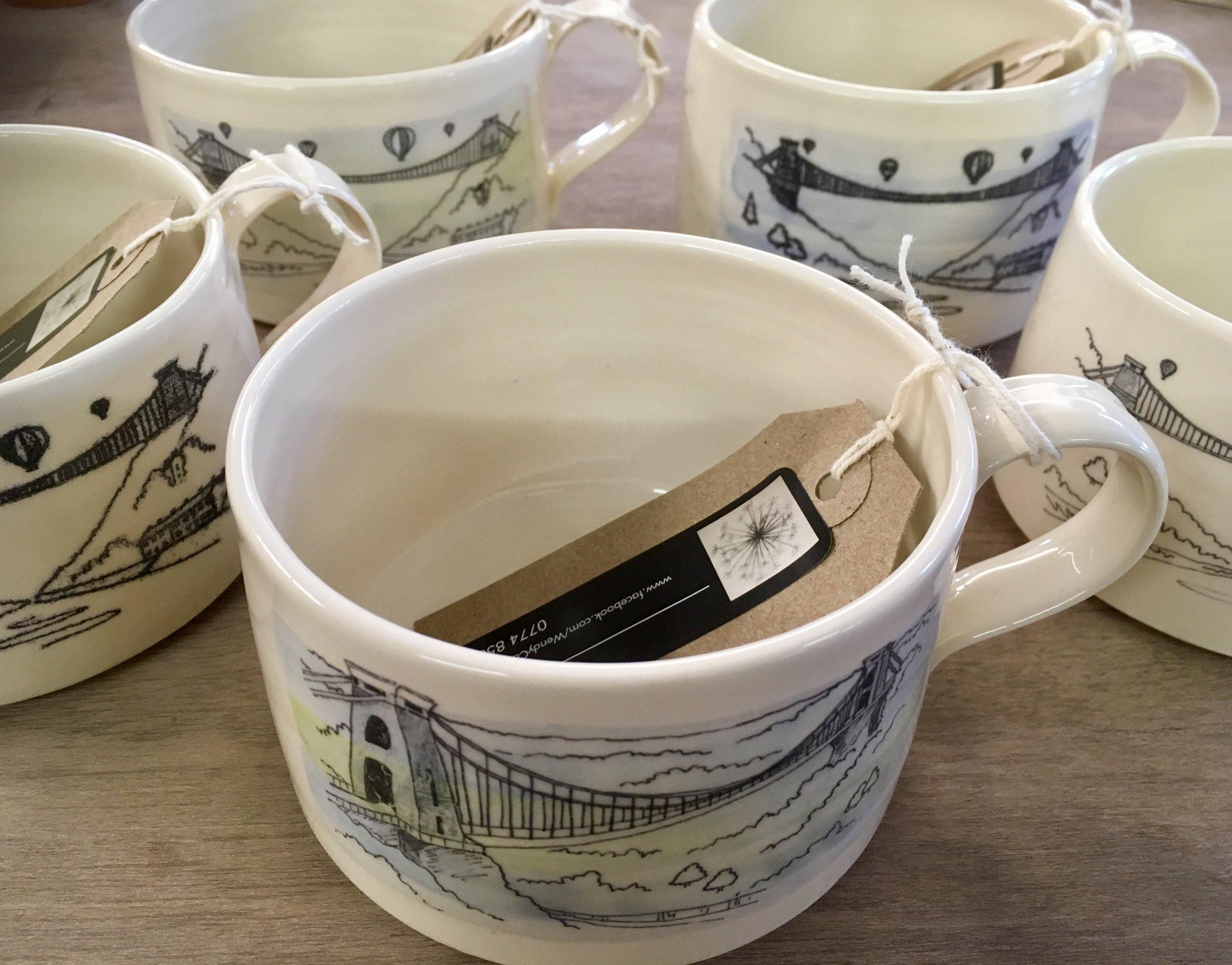 Wendy Calder's mono-printed Bristol Bridge Cream Mugs