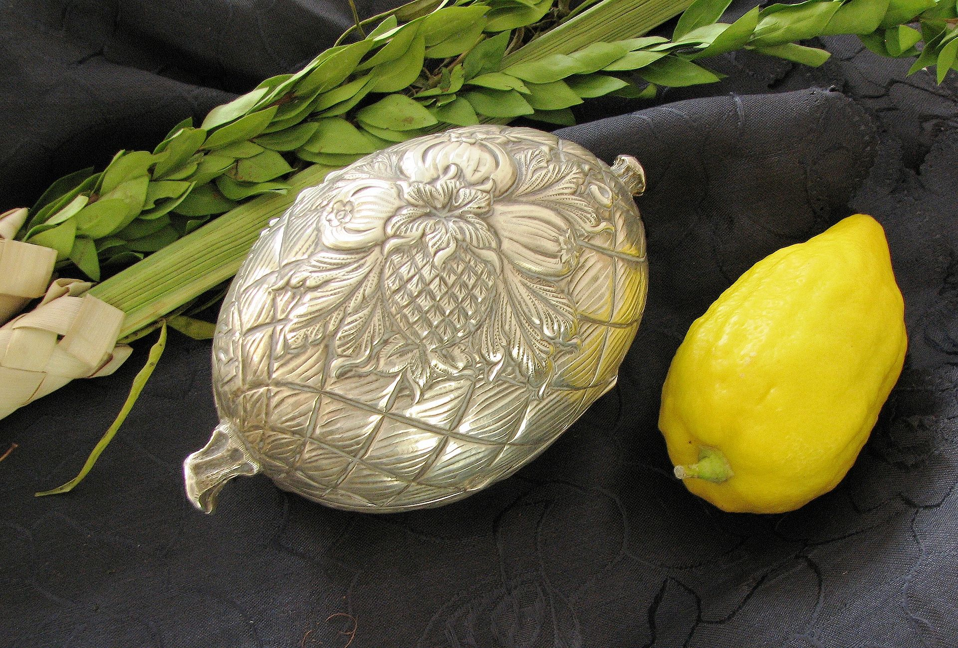 An Etrog, a silver Etrog box, and Lulav; all used on the Jewish holiday of Sukkot