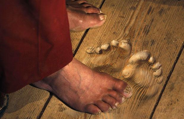 Footprints are carved into the floorboards by monk who has prayed at the same spot for 20 years.jpg