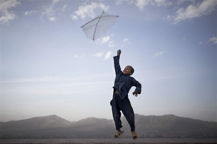 Afghan child flying a kite in the mountains outside Kabul, May 2013.