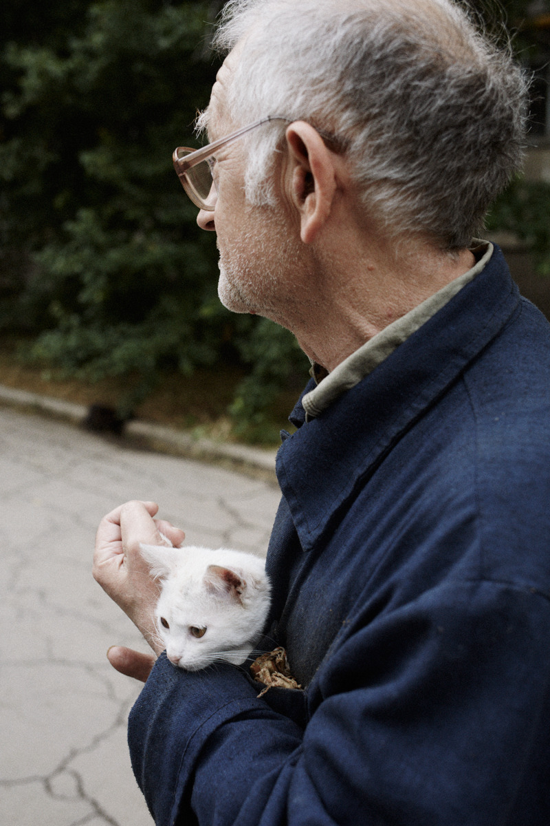 Man with stray kitten, Donetsk, Ukraine, May 2014 .jpg