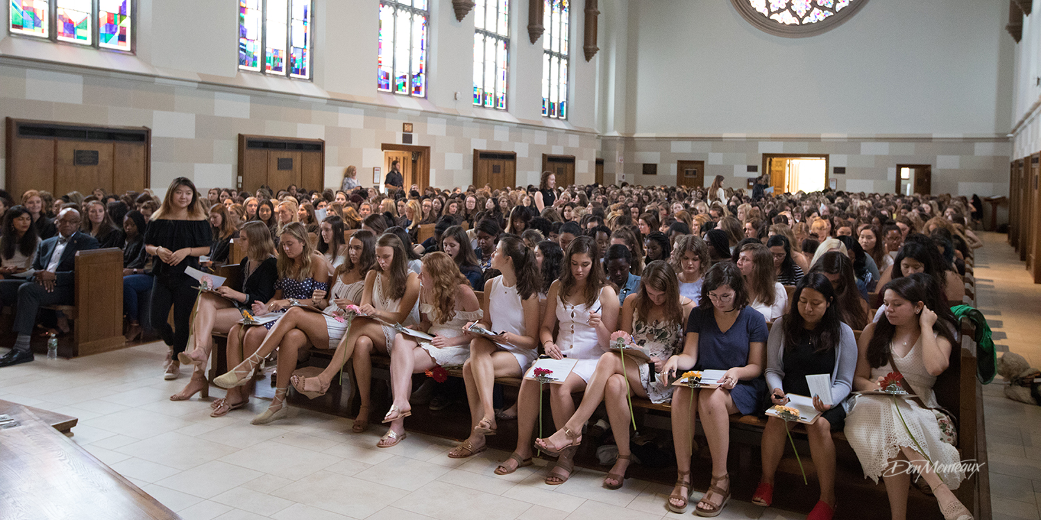 Image of freshman students signing the honor code.