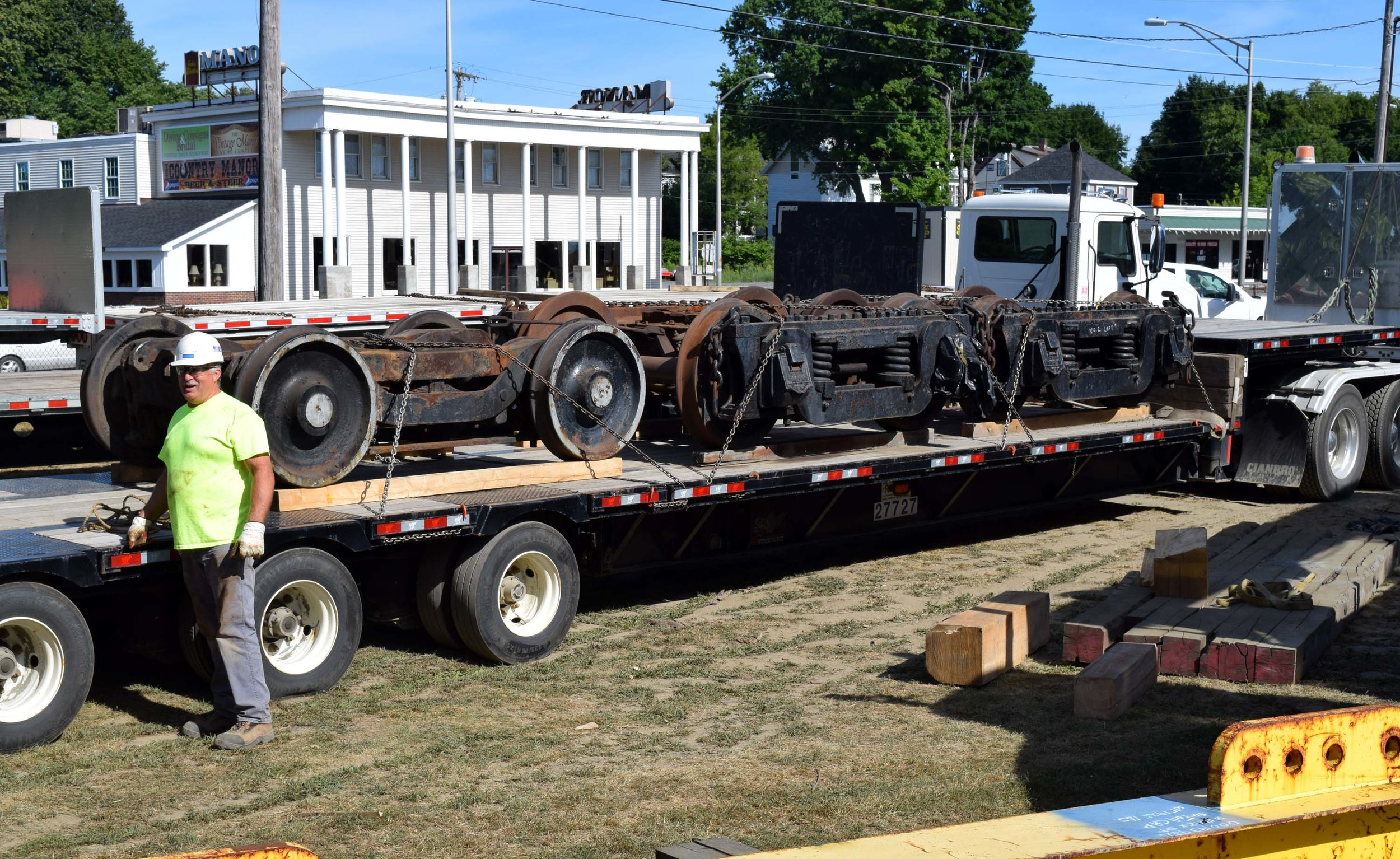 Tender and pony trucks chained down for move.JPG