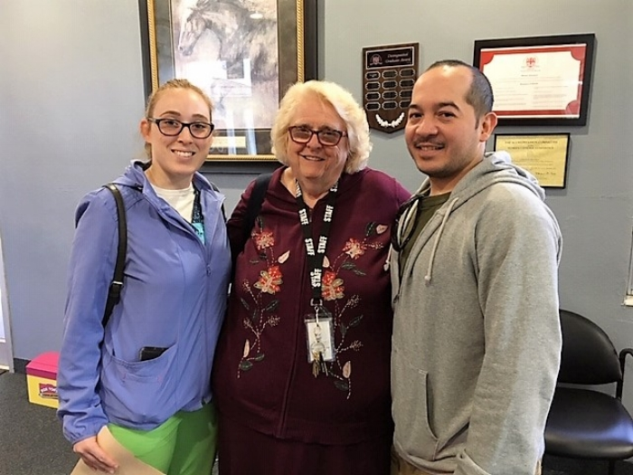 Sebastian Yrizarry '02 visits SJVS teacher, Kathy Foster with his fiancé, Caitlyn Gamache.