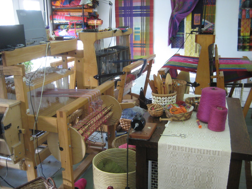 I have the looms arranged back-to-back and a work table with some essential supplies and my electric bobbin winder.