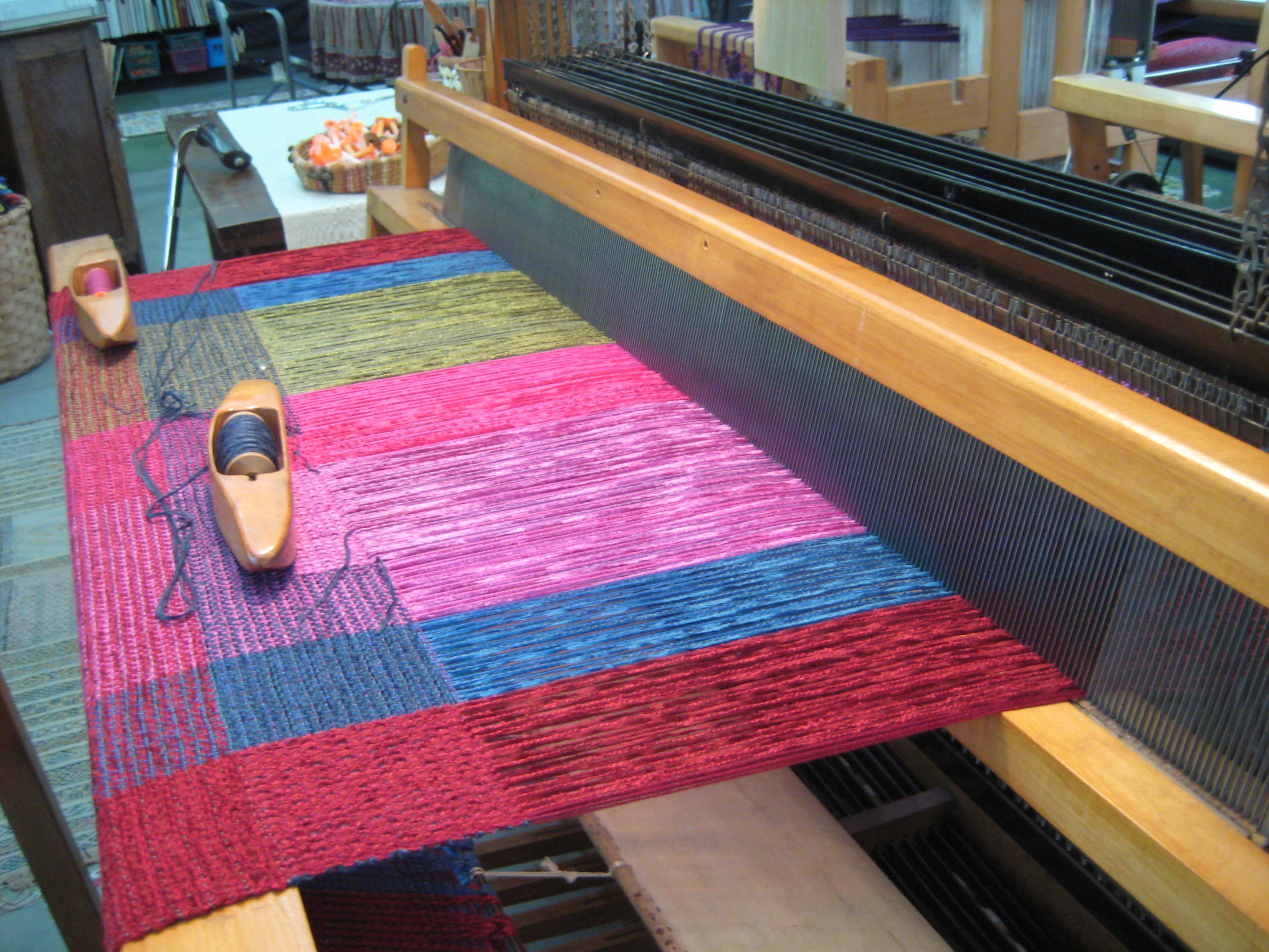 After many hours of preparation the warp is on the loom and weaving can begin.