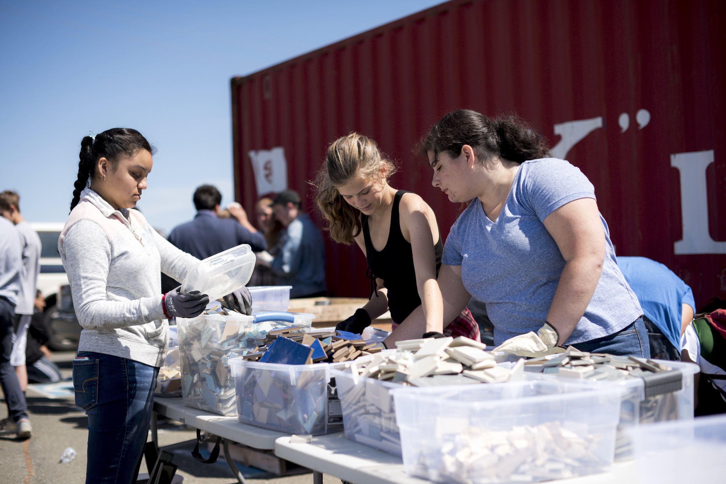 Sorting the broken pieces for Napa Quake Mosaic with local high school students. Photo by Infinity Visuals
