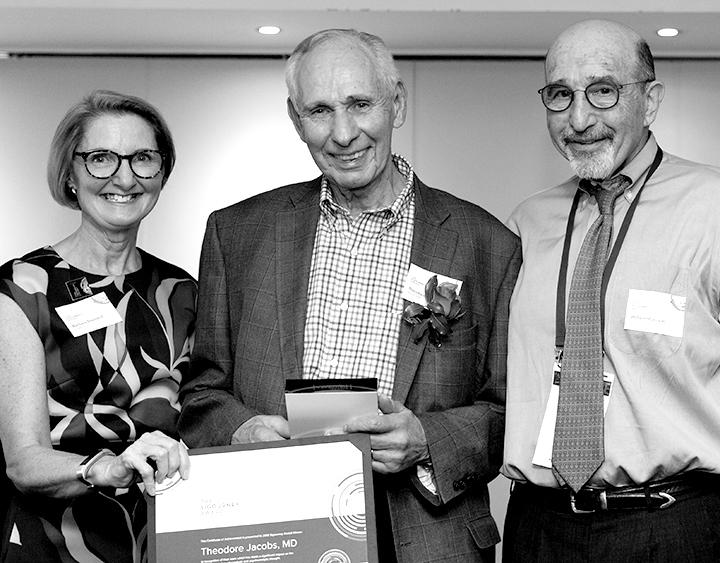 Trustee Barbara Sherland, Winner Theodore Jacobs and Trustee William Myerson