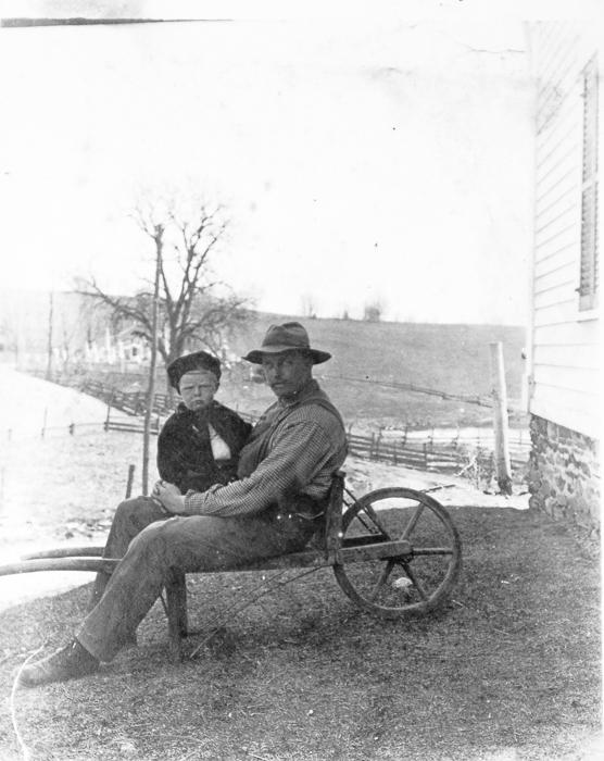 Unidentified man & child
