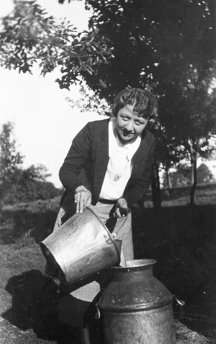 Ruby Austin washing milk pail