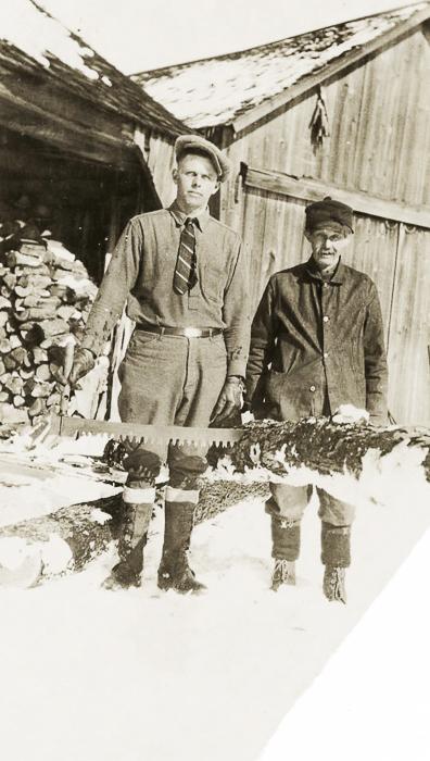 Gordon & Adelbert Austin cutting wood