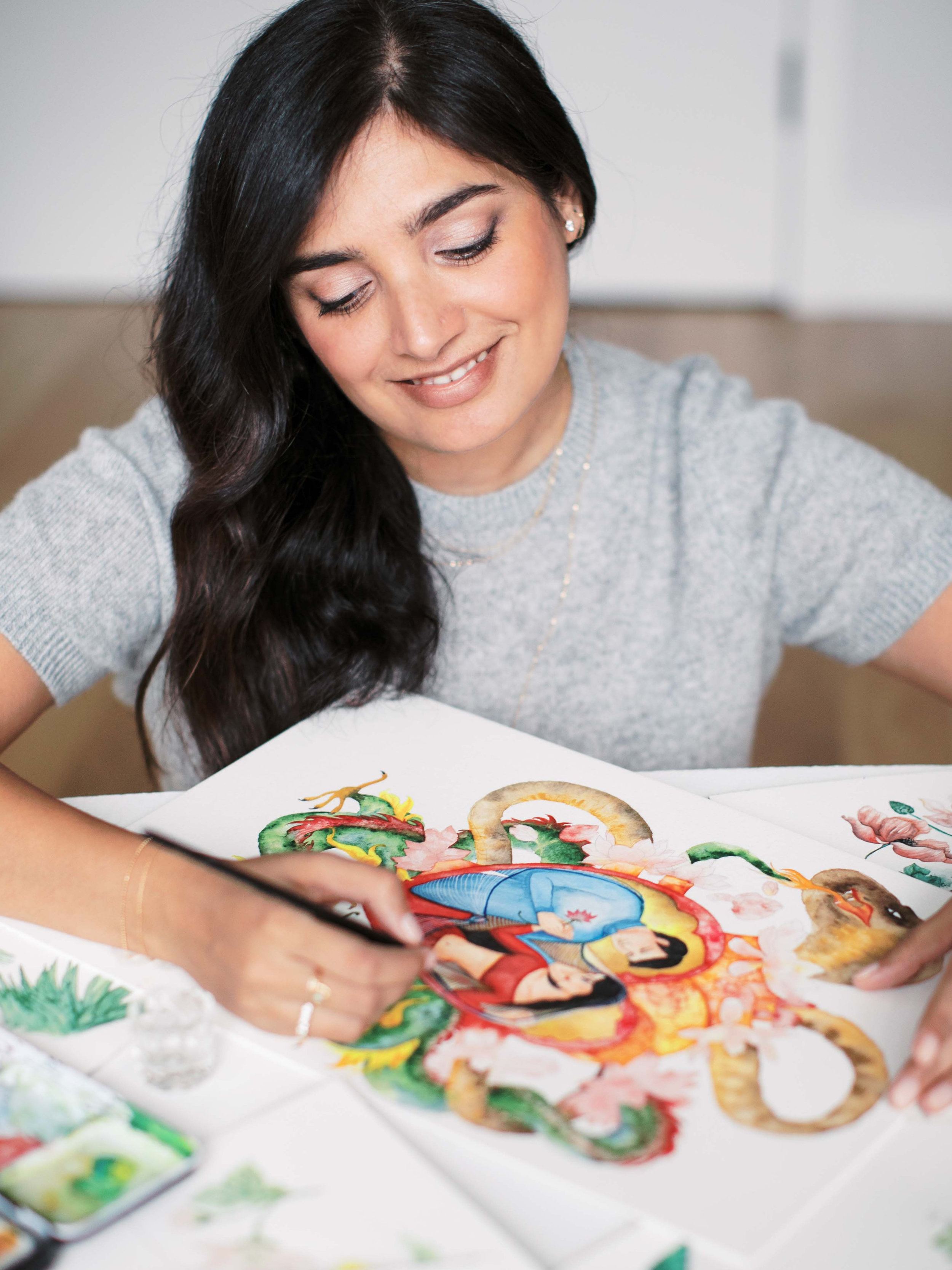 - Formally trained as a graphic designer, Vidhi combines hand painted watercolors, original illustrations, calligraphy and graphic design to make work that is personalized and timeless - something you will treasure for years to come.