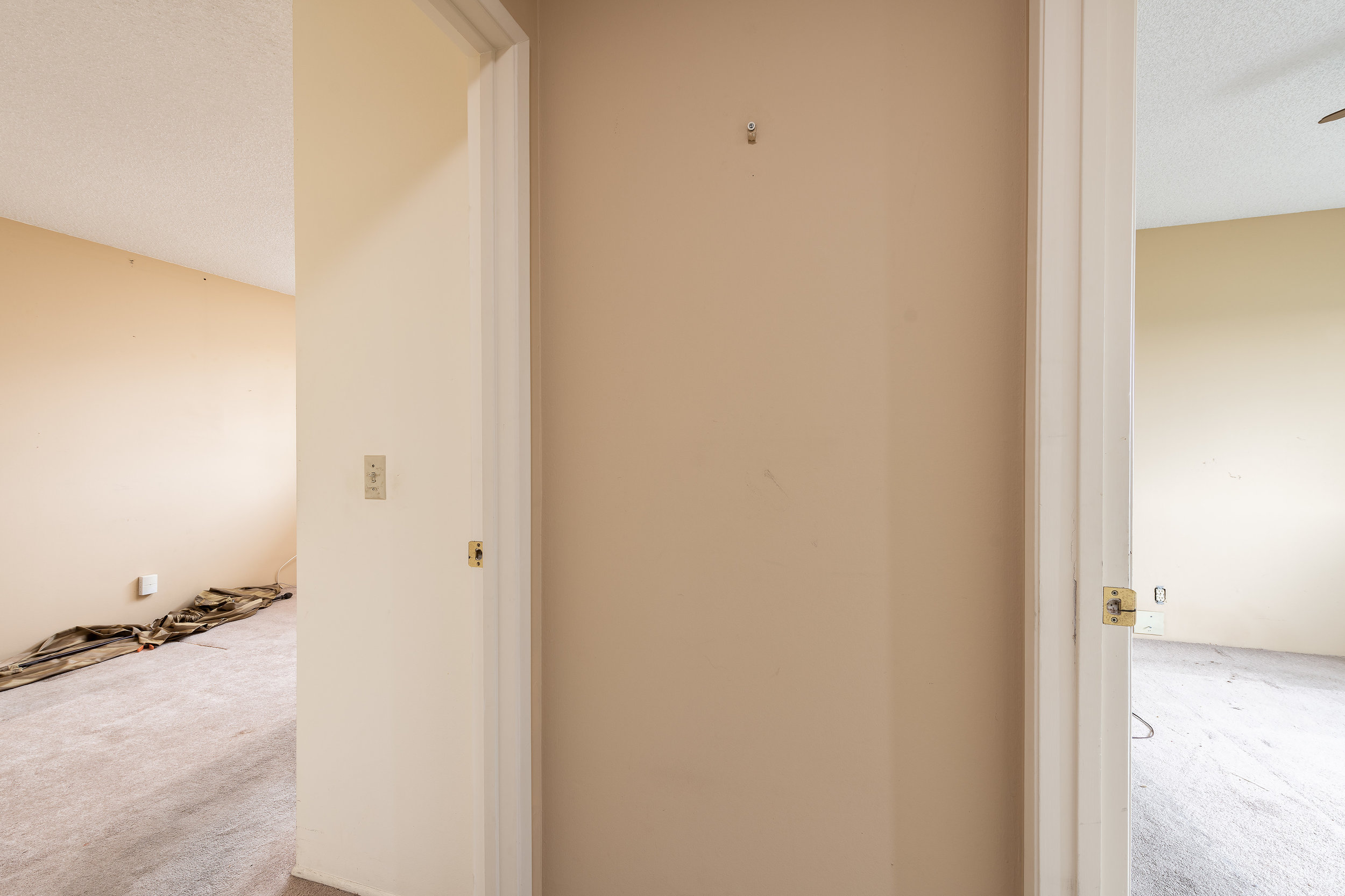 BEFORE   Wall separating the master bedroom and second bedroom