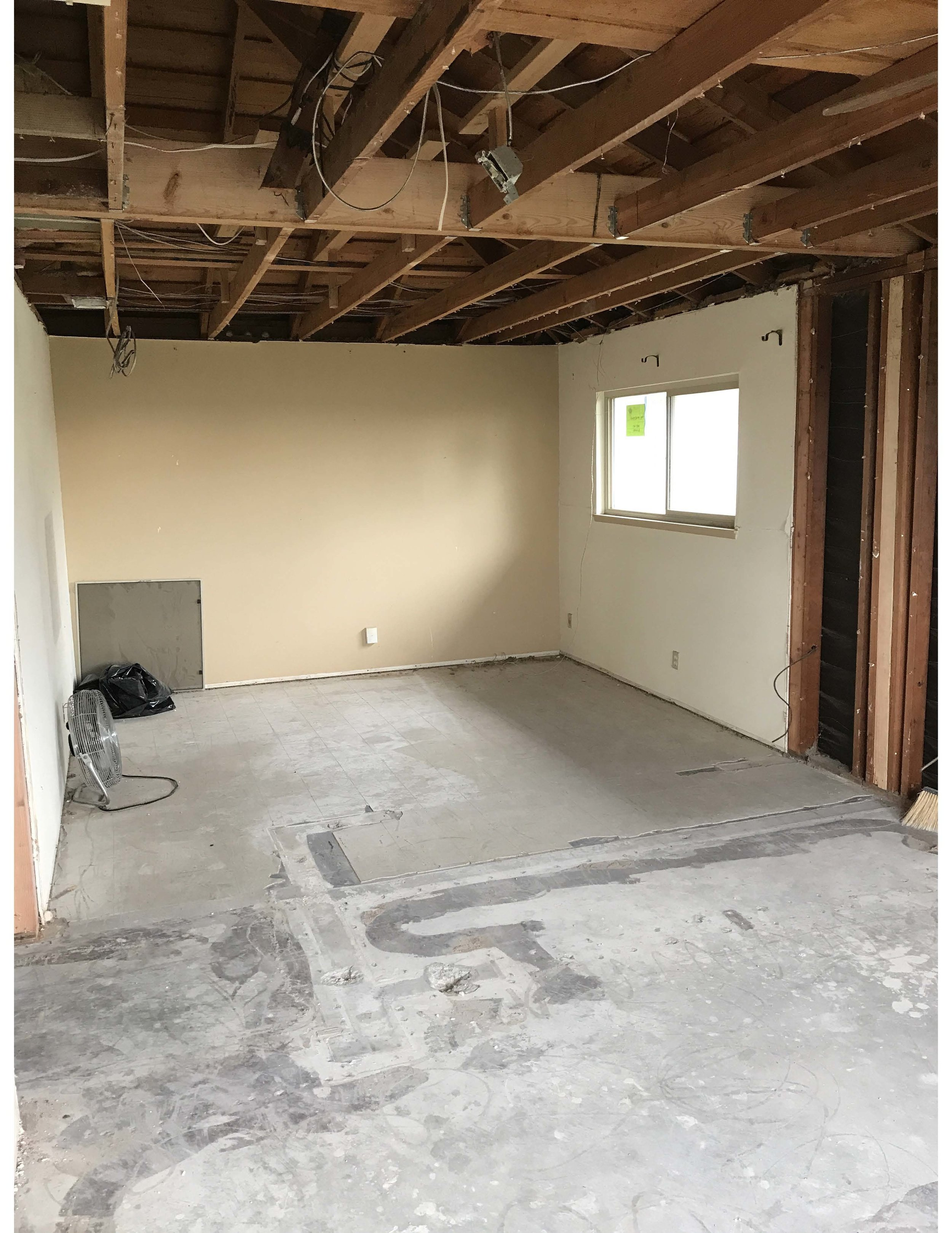 NOW   Master bedroom is now opened up with all new framing. We will be creating a large walk-in closet that will take up a significant portion of what used to be the second bedroom.
