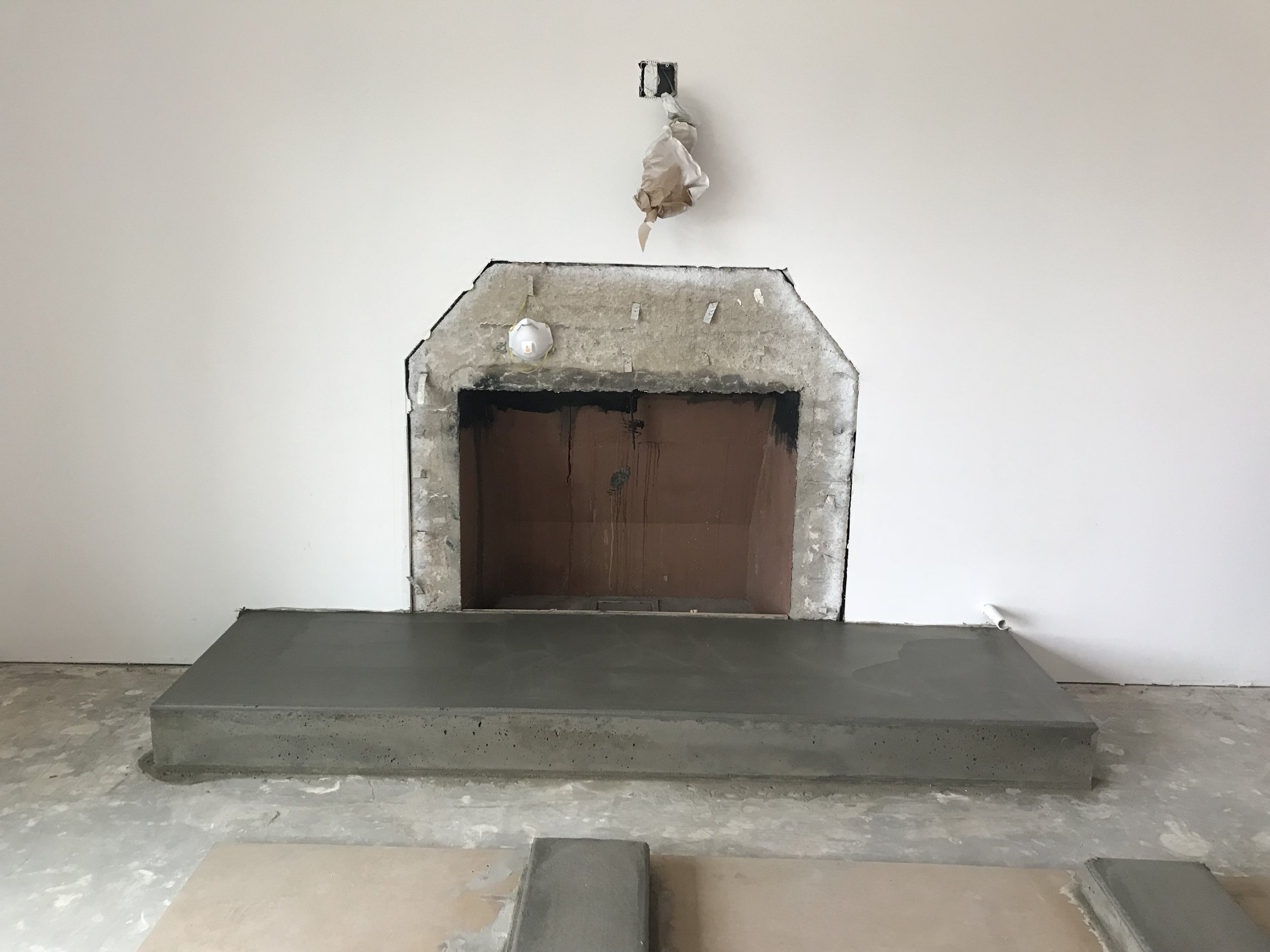 The mold is carefully removed and the concrete is left alone to dry.