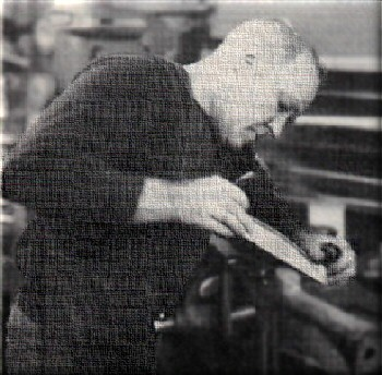 Tom Seitz working diligently on a gun before his passing.""
