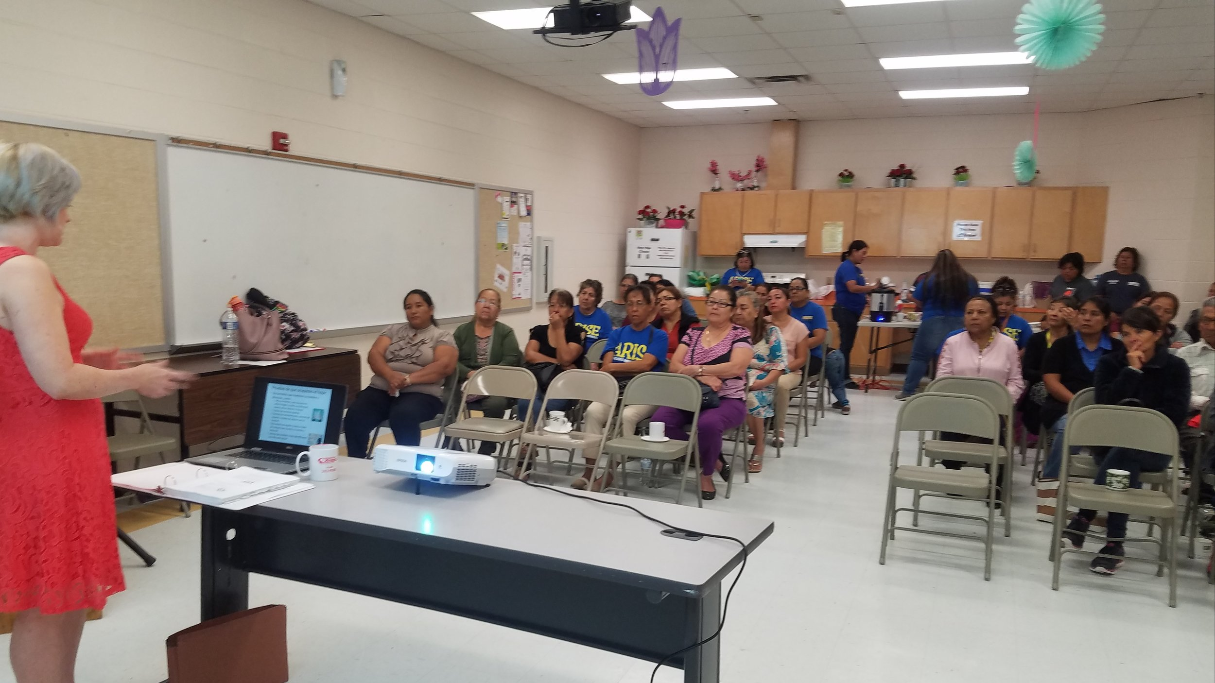 TRLA's Linley Boone-Almaguer provides disaster preparedness training to members of the ARISE community group.