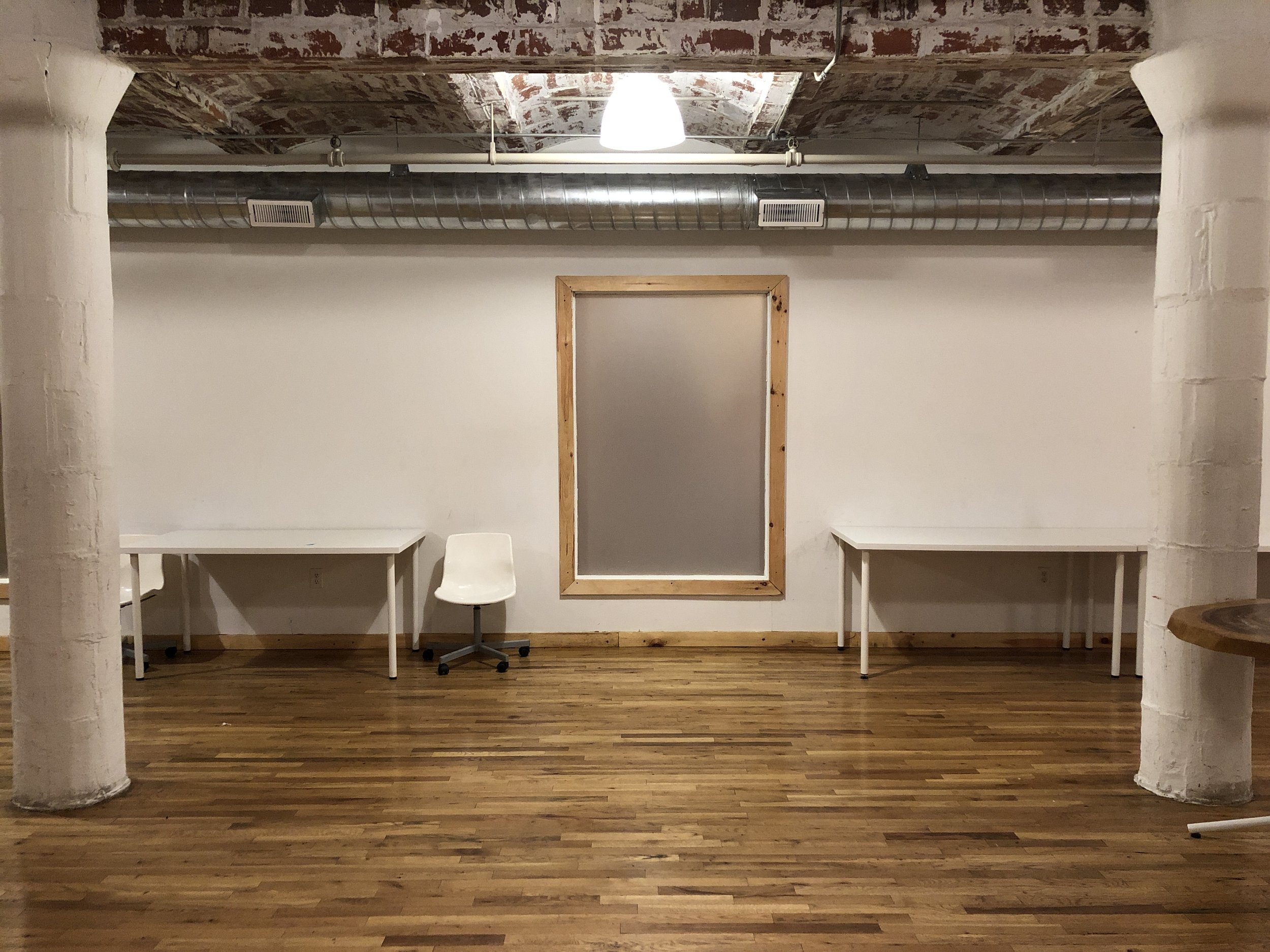 The UN Space - Located in prime dumbo, this space provides it all.6 massive 12+ft high display walls, 3 columns, 3 large windows, 8+ tables, multiple ceiling pipes, exposed brick ceiling, industrial lighting, 18+ chairs & easy access.