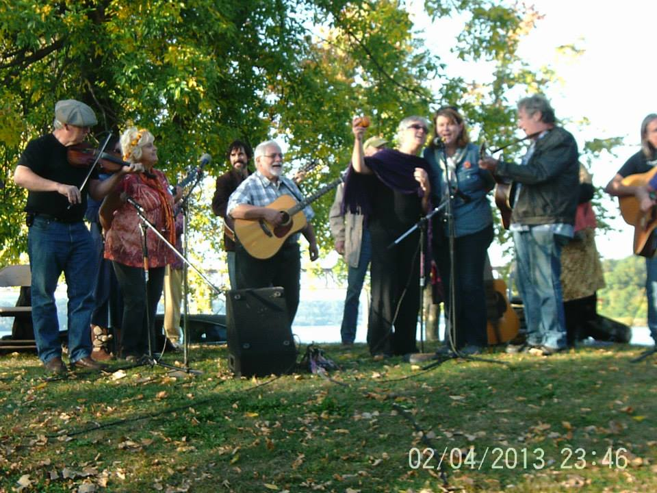 Singing on the hill with friends at Pete and Toshi Seeger Memorial Park, Hudson River, Beacon NY.