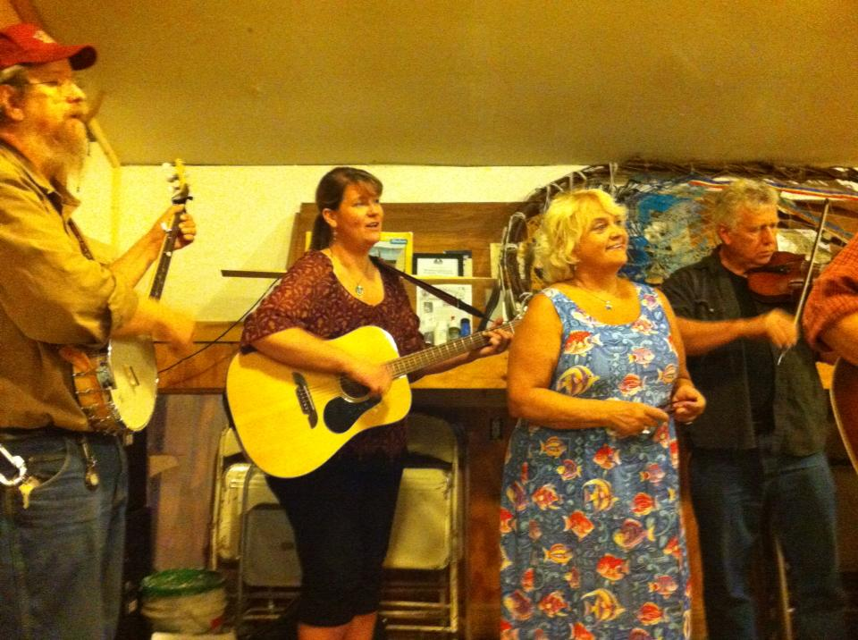 Singing with friends to open the meeting, Beacon Sloop Club, Beacon NY.