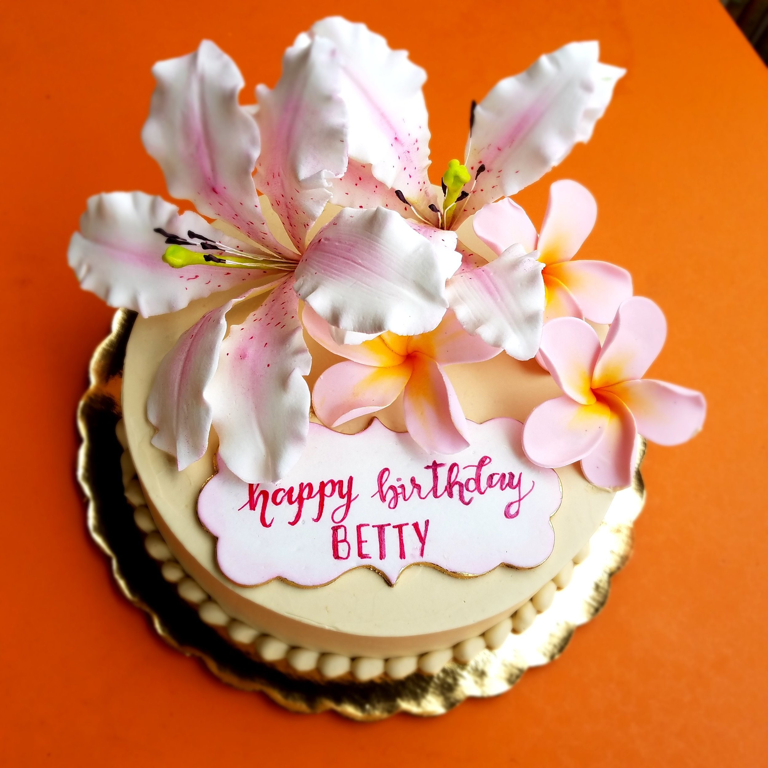Copy of Buttercream birthday cake with sugar lilies and plumerias Hilo Hawaii Big Island Kailua-Kona
