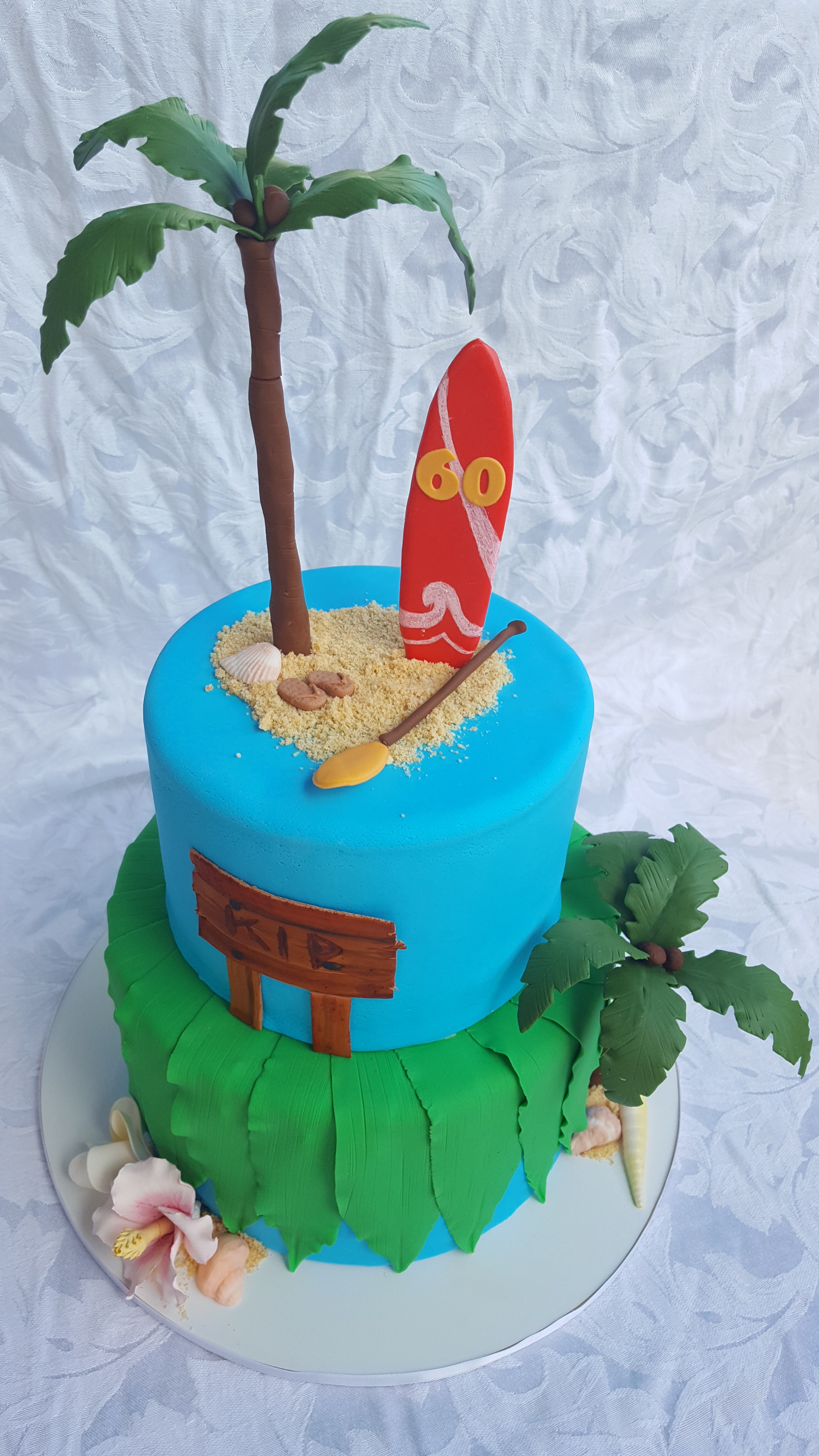 Copy of Two tier rolled fondant birthday cake with sugar palm tree and surf board Hilo Hawaii Big Island Kailua-Kona