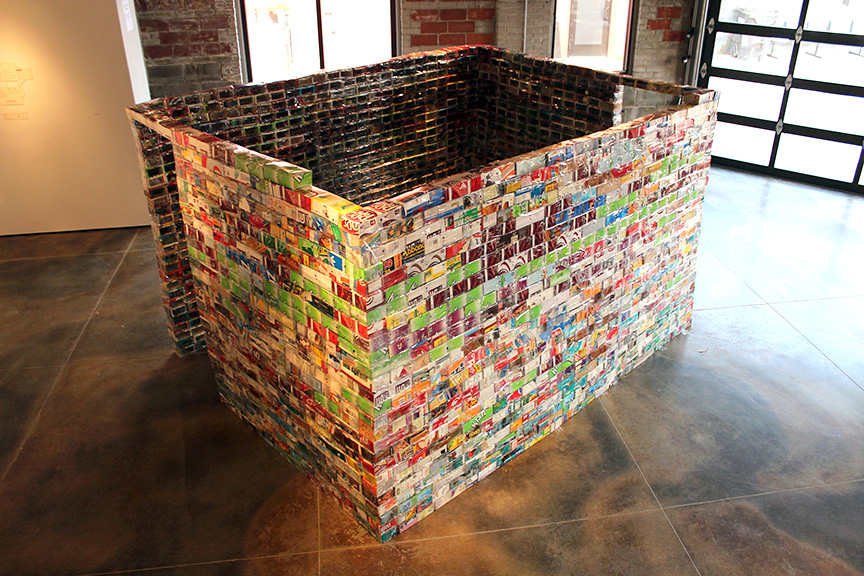 Archival Structure 5: Bricks (Speculative Equivalent, version). Conserved paperboard and PVC packaging, conserved and donated ephemera and detritus, 6 x 10 x 10', Hutchinson Center for the Arts, 2016.