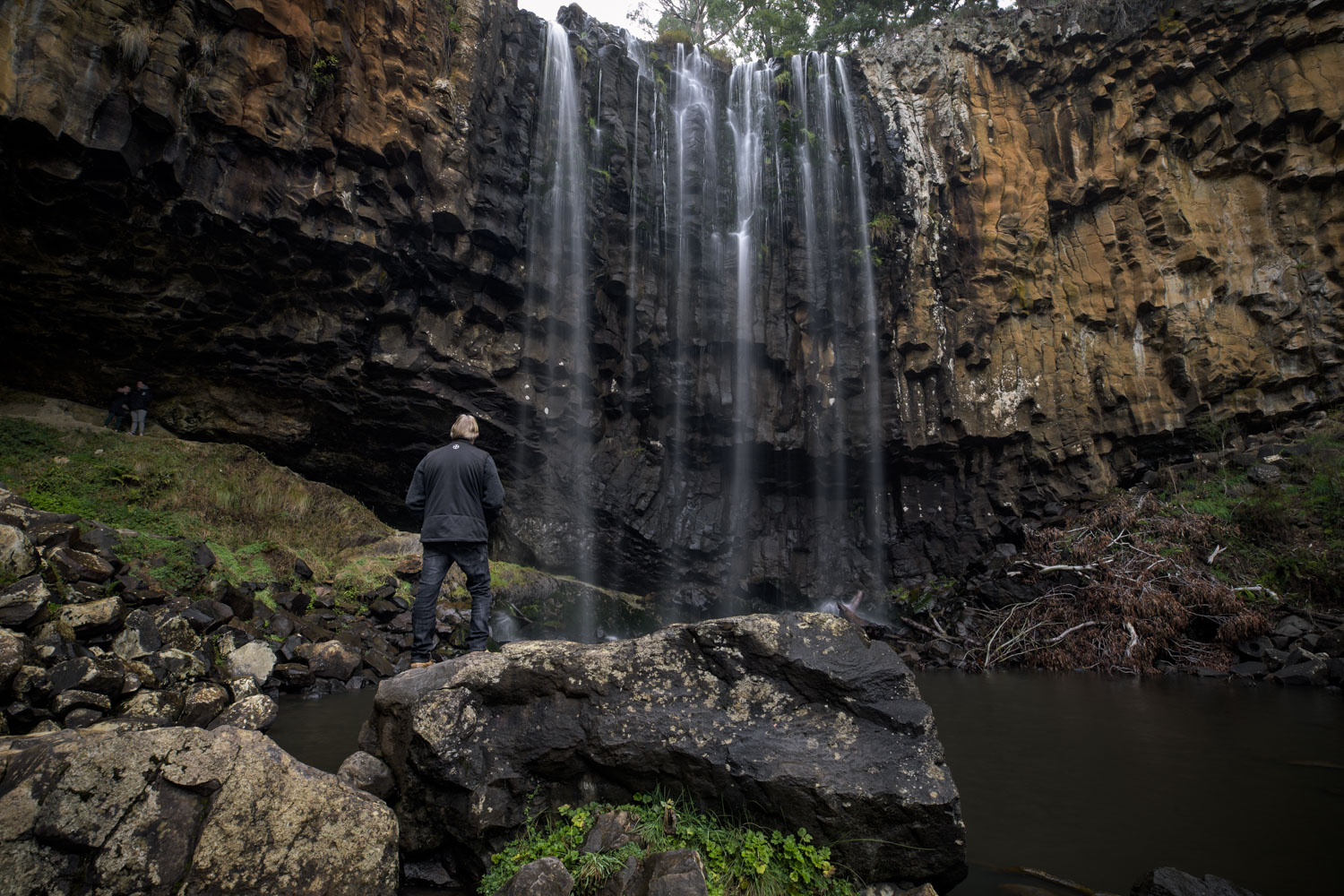 """""""The most devastation can be seen on the paths to and from the 'selfie rock' at the base of the falls. The grey stains on the rocks are remnants of the once thriving moss"""" - Graham Miles"""